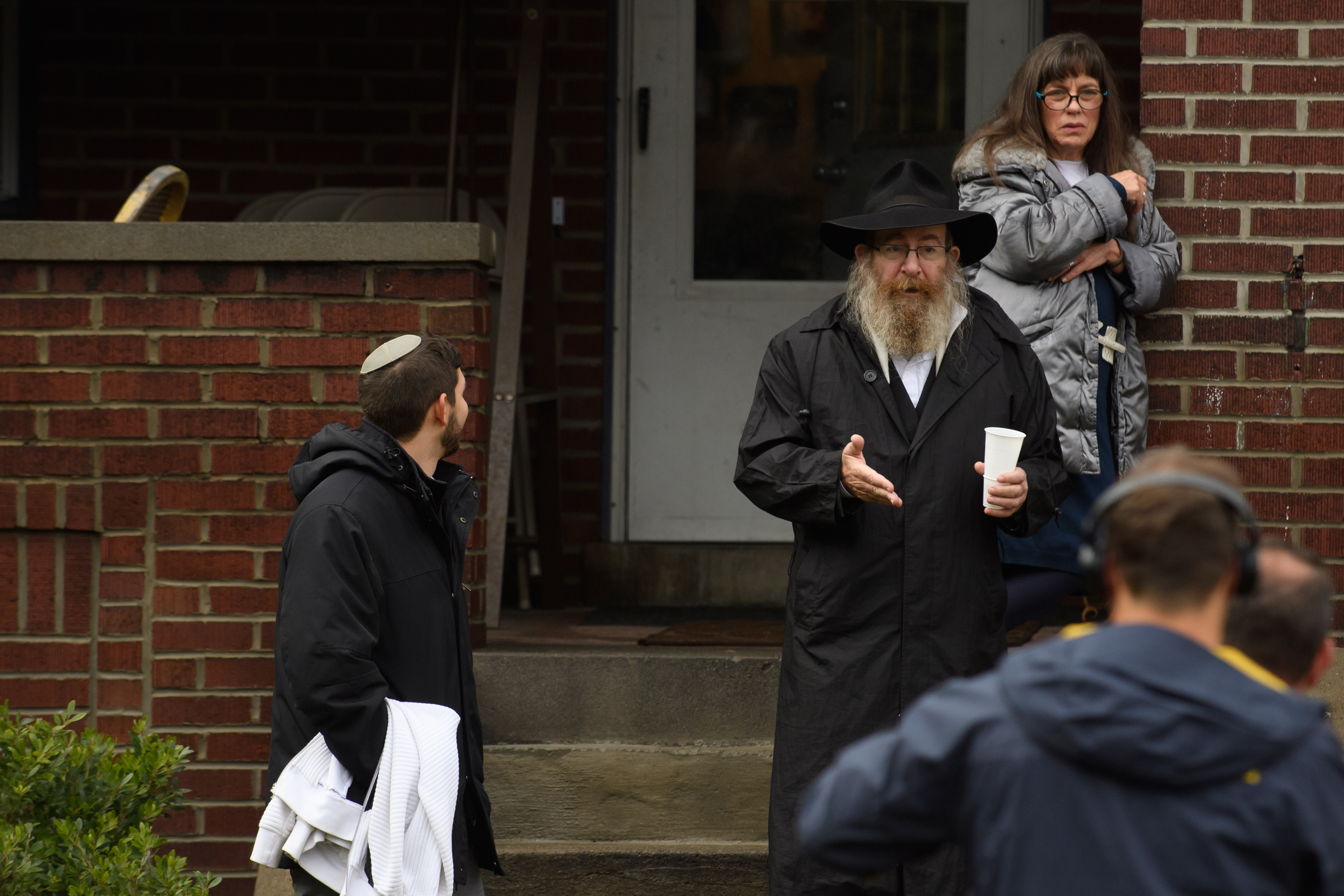 Residents talk to the media near the site of a mass shooting at the Tree of Life Synagogue in the Squirrel Hill neighborhood on October 27, 2018 in Pittsburgh, Pennsylvania. (Getty Images)