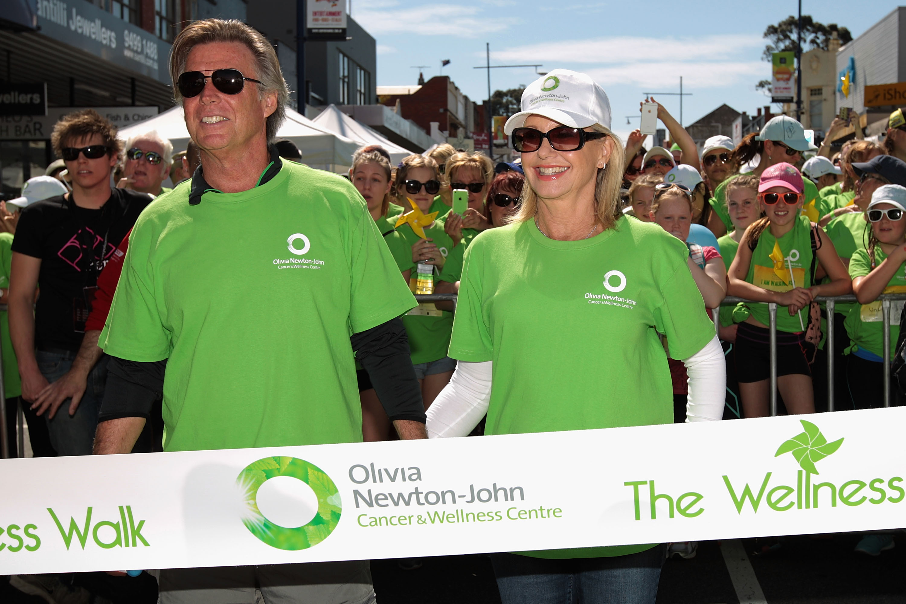 Olivia Newton-John and husband John Easterling supports the Cancer & Wellness Centre by leading the way on this charitable walk at The Centre Ivanhoe on September 28, 2014 in Melbourne, Australia. The walk aims to raise funds for the wellness and supportive care programs provided to patients.