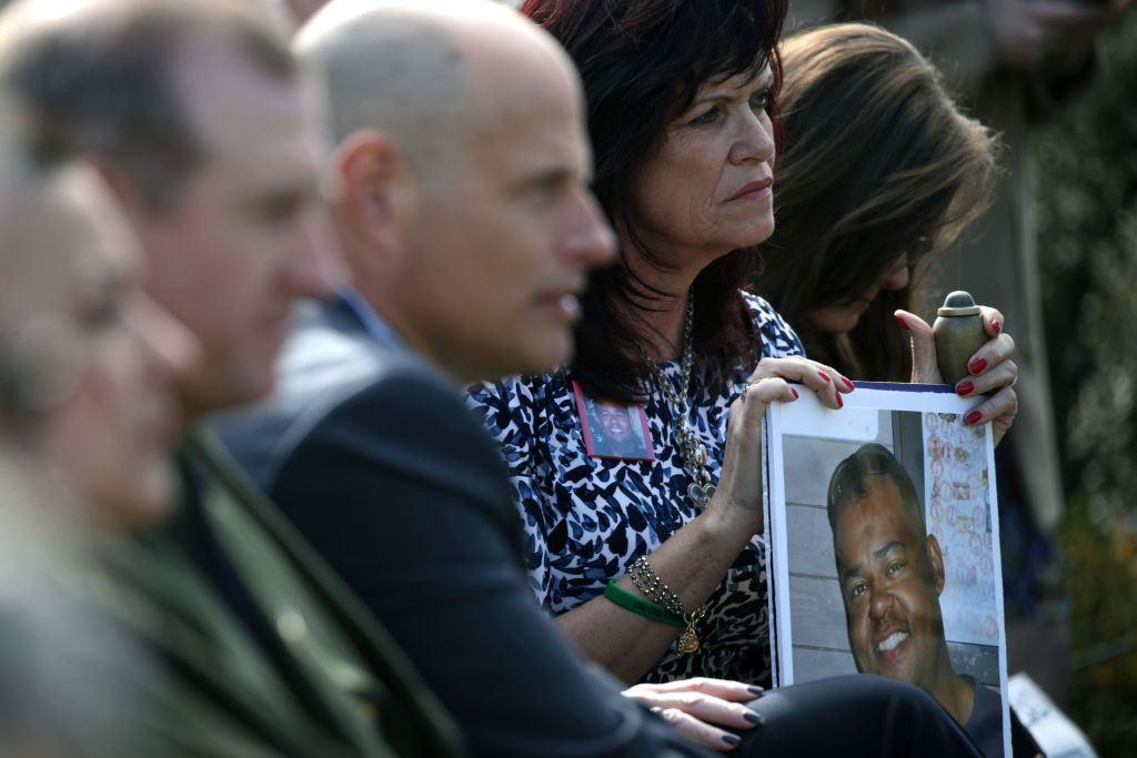 Relatives of victims killed by illegal immigrants listen as U.S. President Donald Trump speaks on border security during a Rose Garden event at the White House February 15, 2019 in Washington, DC. President Trump is expected to declare a national emergency to free up federal funding to build a wall along the southern border. (Photo by Alex Wong/Getty Images)