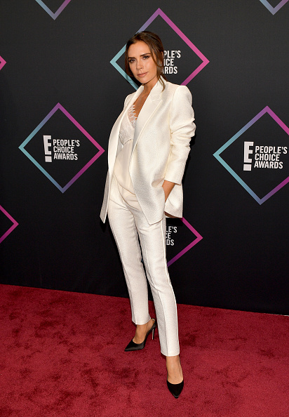 Posh spice loves her cigarette pants! Victoria Beckham stepped on the red carpet in an all-white outside, complete with a classic black bump. No pops of color, just pristine! (Photo by Matt Winkelmeyer/Getty Images)