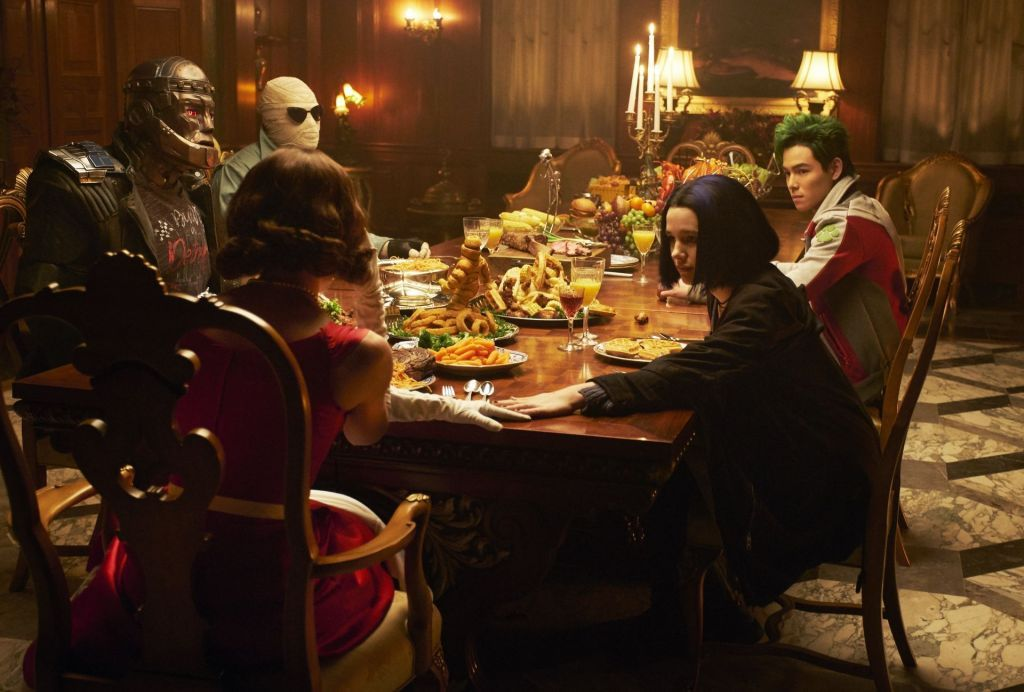 The 'Doom Patrol' team and Raven share a meal together. (Source: IMDB)