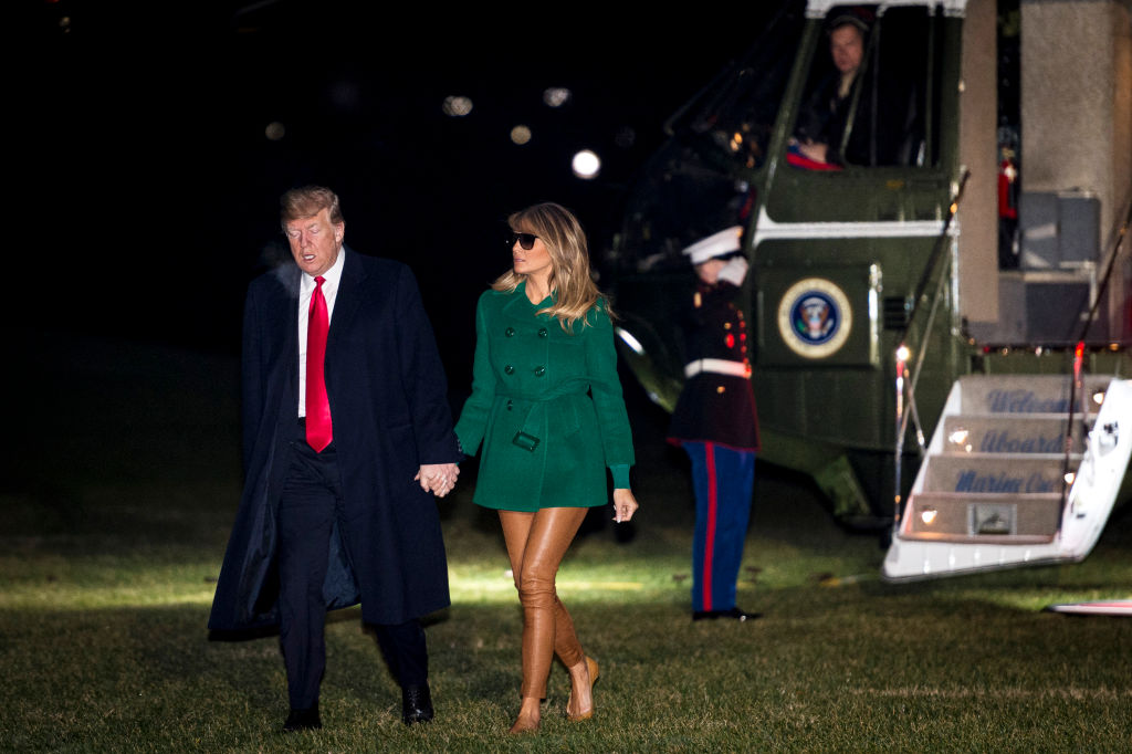 President Donald Trump and First Lady Melania Trump make their way across the South Lawn of the White House after returning on Marine One from their surprise trip to Al Asad Air Base in Iraq to visit troops, on December 27, 2018, in Washington, DC. (Photo by Pete Marovich - Pool/Getty Images)