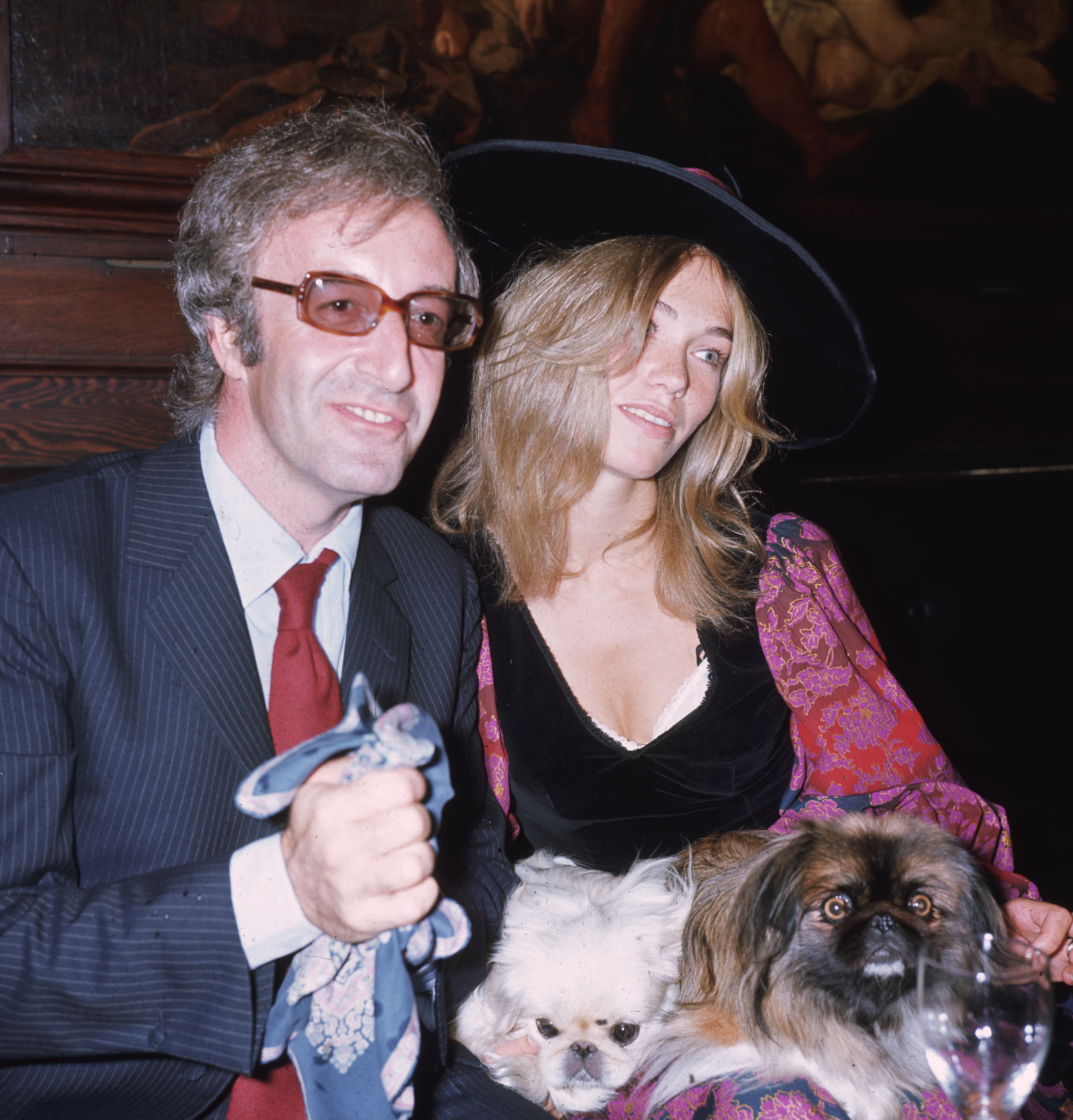 English comedian and actor Peter Sellers with his third wife, Miranda Quarry, the stepdaughter of Lord Mancroft, deputy chairman of Cunard's, at their wedding reception at 'Tramp' in Jermyn Street, with Miranda's two pekinese dogs. (Photo by George Hales/Getty Images)