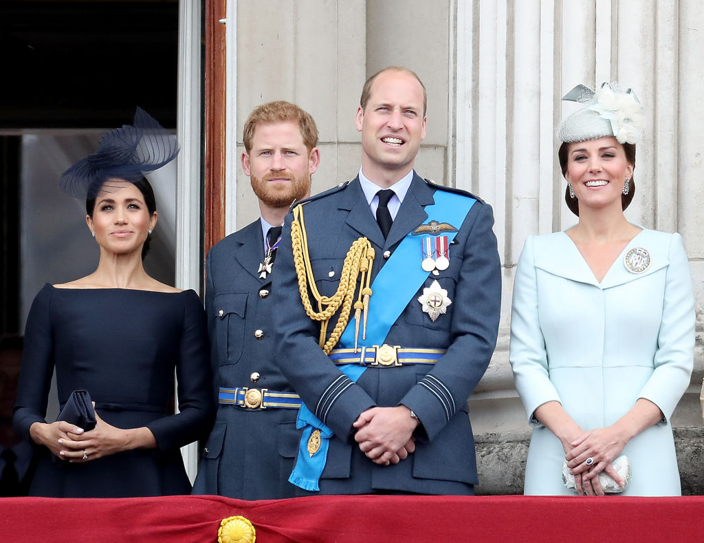 Meghan, Duchess of Sussex, Prince Harry, Duke of Sussex, Prince William, Duke of Cambridge and Catherine, Duchess of Cambridge watch the RAF flypast on the balcony of Buckingham Palace, as members of the Royal Family attend events to mark the centenary of the RAF on July 10, 2018, in London (Source: Chris Jackson/Chris Jackson/Getty Images)