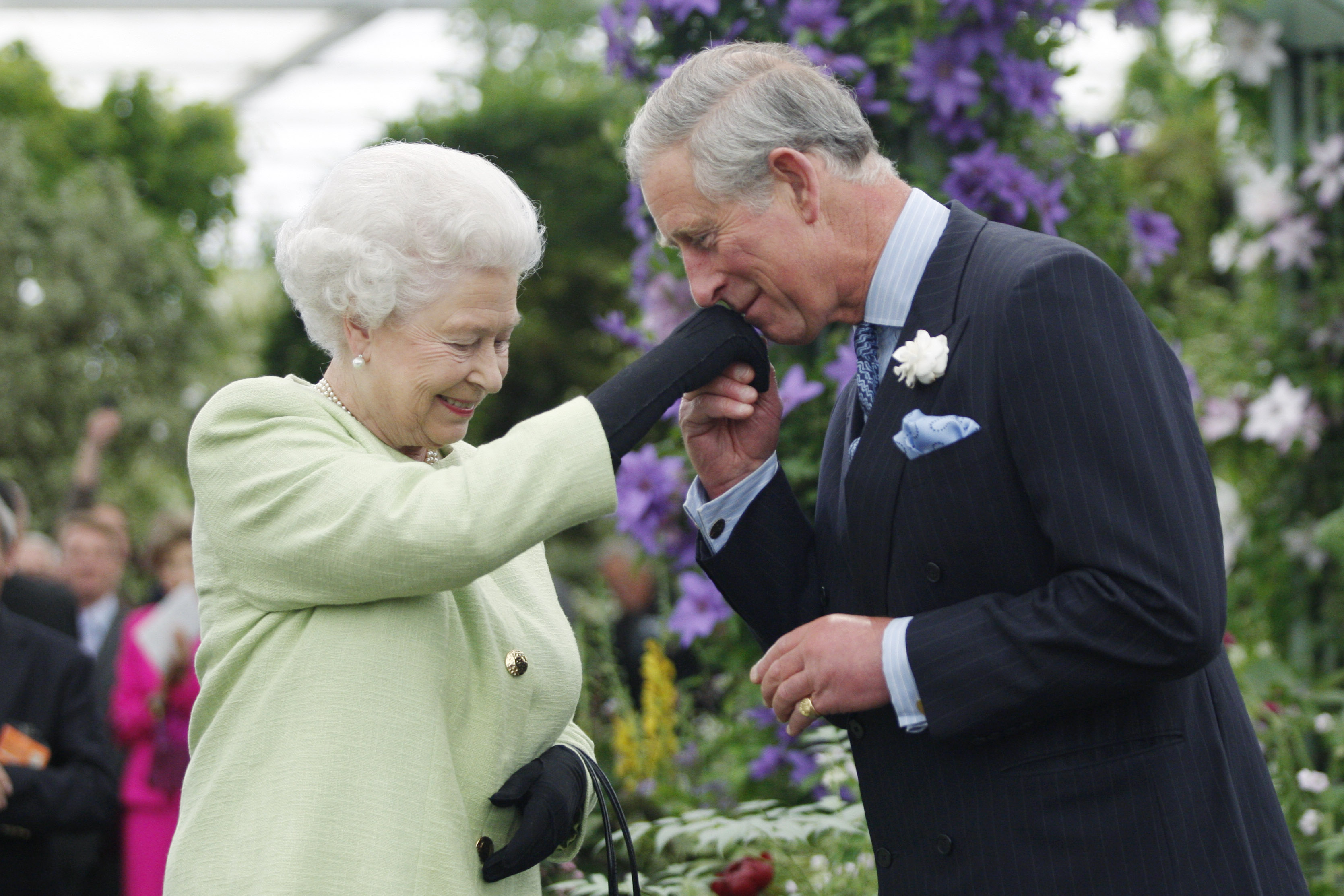 Queen Elizabeth II presents Prince Charles, Prince of Wales with the Royal Horticultural Society's Victoria Medal of Honour during a visit to the Chelsea Flower Show on May 18, 2009 in London. (Photo by Sang Tan/WPA Pool/Getty Images)