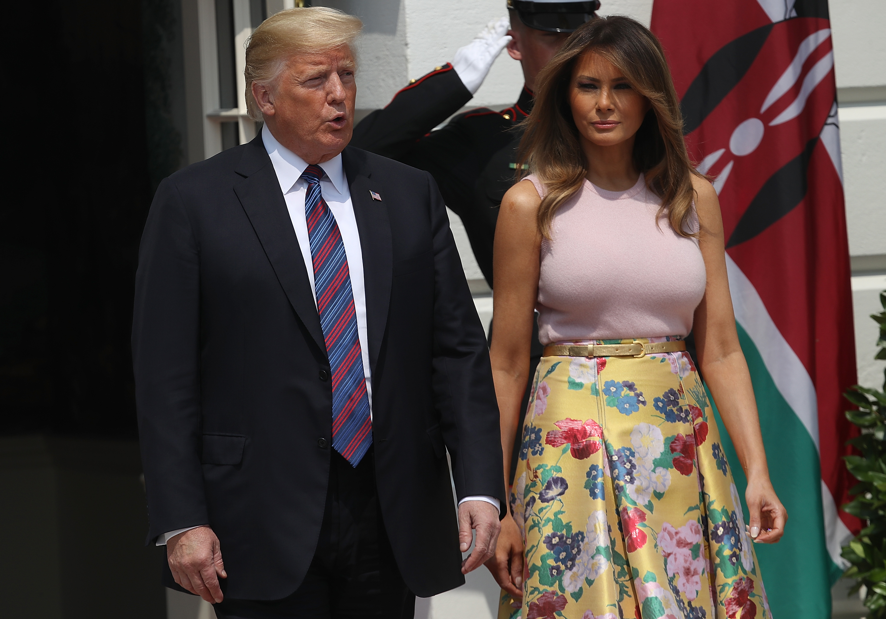U.S. President Donald Trump and first lady Melania Trump walk from the White House to welcome Kenyan President Uhuru Muigai Kenyatta August 27, 2018 in Washington, DC.