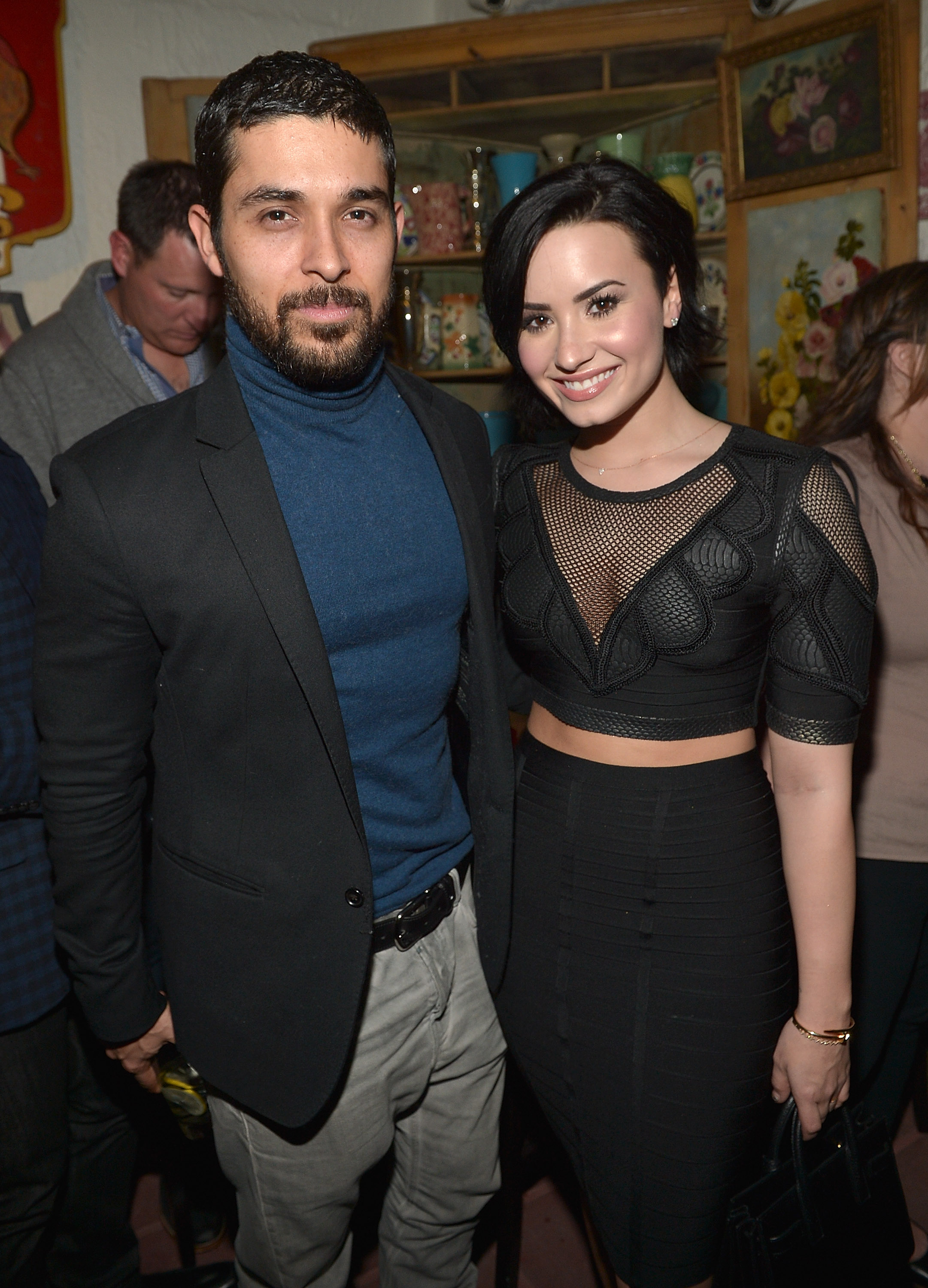 Wilmer Valderrama and Demi Lovato celebrate Nick Jonas' song 'Jealous' being the #1 At Top 40 radio hit at The Ivy on January 20, 2015, in Los Angeles, United States. (Source: Getty Images)