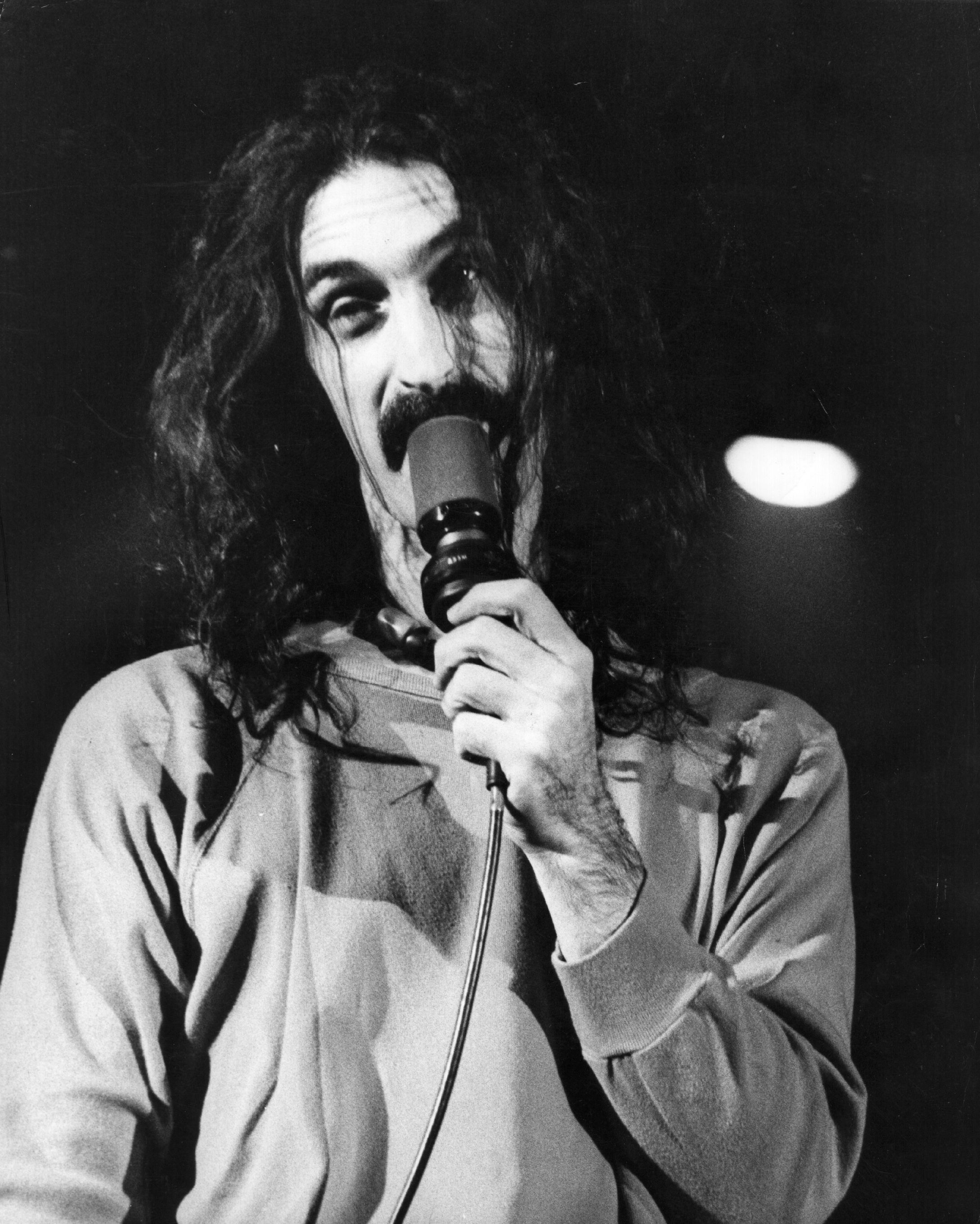 American experimental rock singer, songwriter, guitarist and composer Frank Zappa (1940 - 1993), on stage at the Hammersmith Odeon, London. (Source: Getty Images)