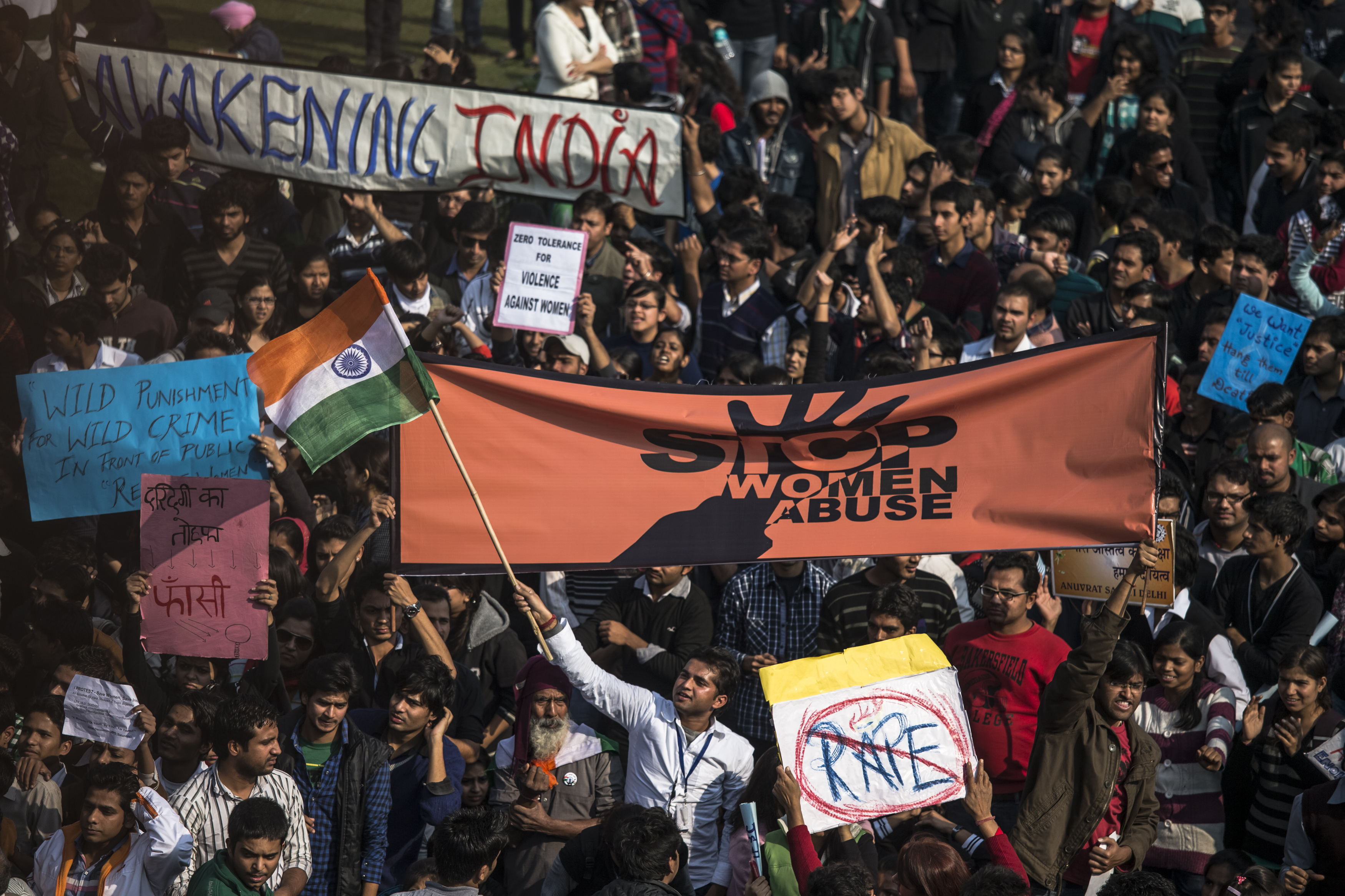Students hold up placards as they chant slogans in front of a Police cordon during a protest in front of the Presidential Palace on December 22, 2012, in New Delhi, India. (Getty)