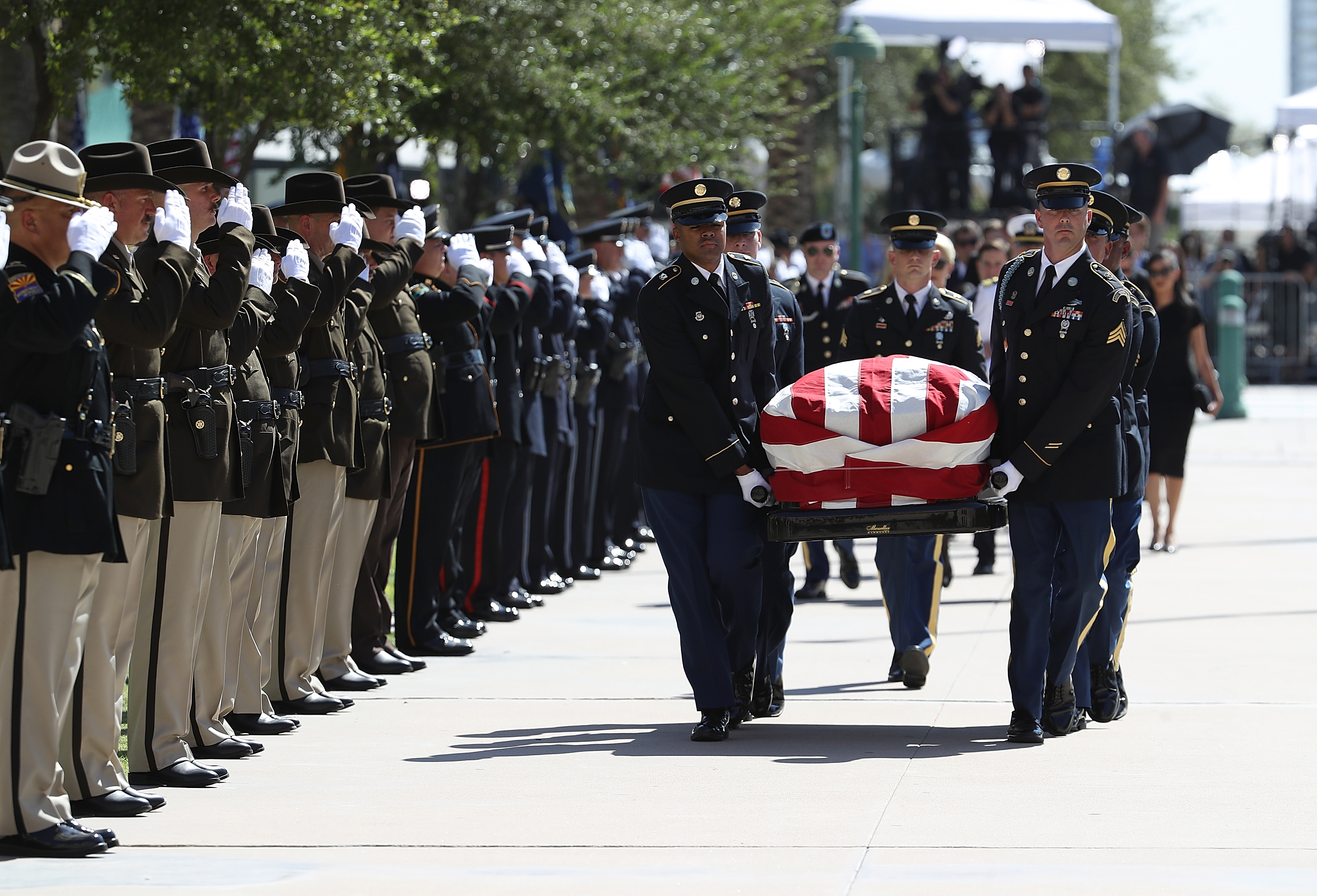 The casket of US Sen John McCain (R-AZ) is carried into the Arizona State Capitol on August 29, 2018 in Phoenix, Arizona. US Sen John McCain will lie in State at the Arizona State Capitol before being transported to Washington DC where he will be buried at the US Naval Academy Cemetery in Annapolis. Sen McCain, a decorated war hero, died August 25 at the age of 81 after a long battle with Glioblastoma, a form of brain cancer.
