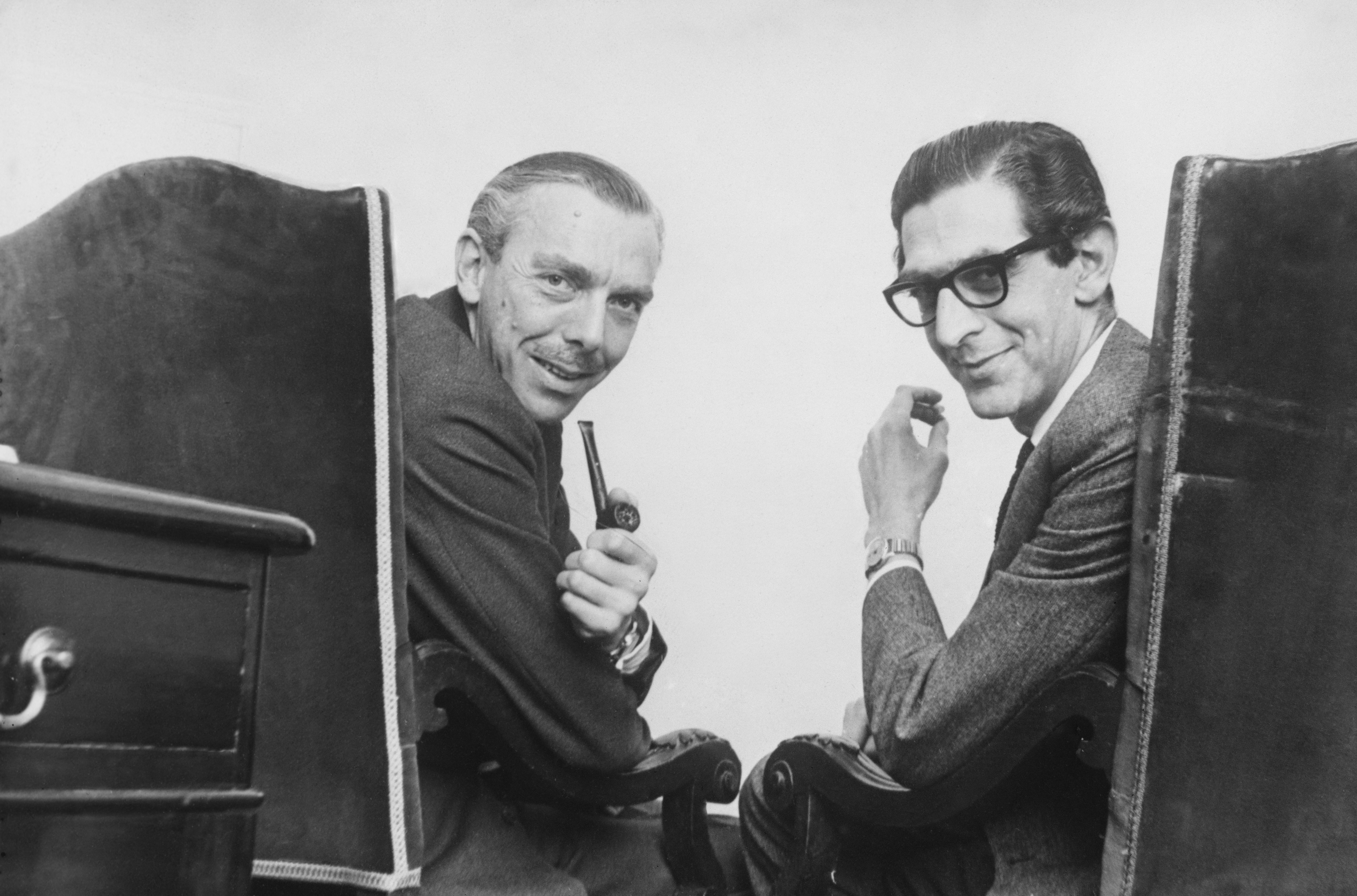 English comedy writers Frank Muir (1920 - 1998, left) and Denis Norden (1922 - 2018) at their office in Regent Street, London, 30th April 1963. (Photo by Hulton Archive/Getty Images)
