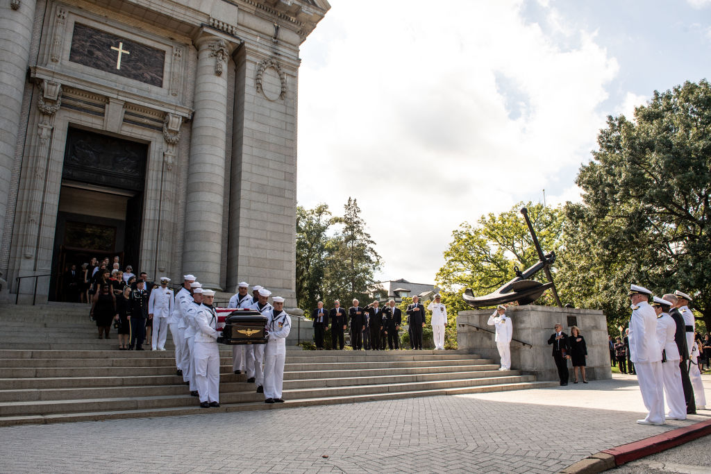 Navy Body Bearers move the casket of the late Senator John McCain to a horse-drawn caisson after his funeral service at the United States Naval Academy Chapel, September 2, 2018 in Annapolis, Maryland.  (Photo by Mass Communication Specialist 2nd Class Nathan Burke/U.S. Navy via Getty Images)
