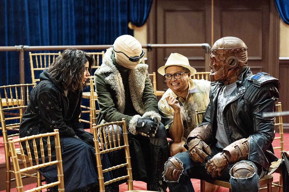 The team sitting with Animal-Vegetable-Mineral Man before his transformation in DC's 'Doom Patrol'. (Source: IMDB)