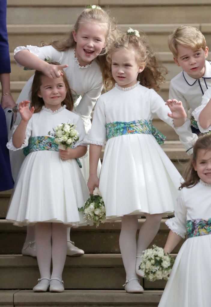 Bridesmaids Princess Charlotte of Cambridge, Savannah Phillips, Maud Windsor and page boy Prince George of Cambridge on the steps after the wedding of Princess Eugenie of York and Jack Brooksbank at St. George's Chapel on October 12, 2018, in Windsor, England. (Getty Images)