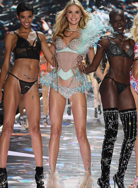 Megan Puleri (centre) walks the runway during the 2018 Victoria's Secret Fashion Show at Pier 94 on November 8, 2018, in New York City. (Getty Images)