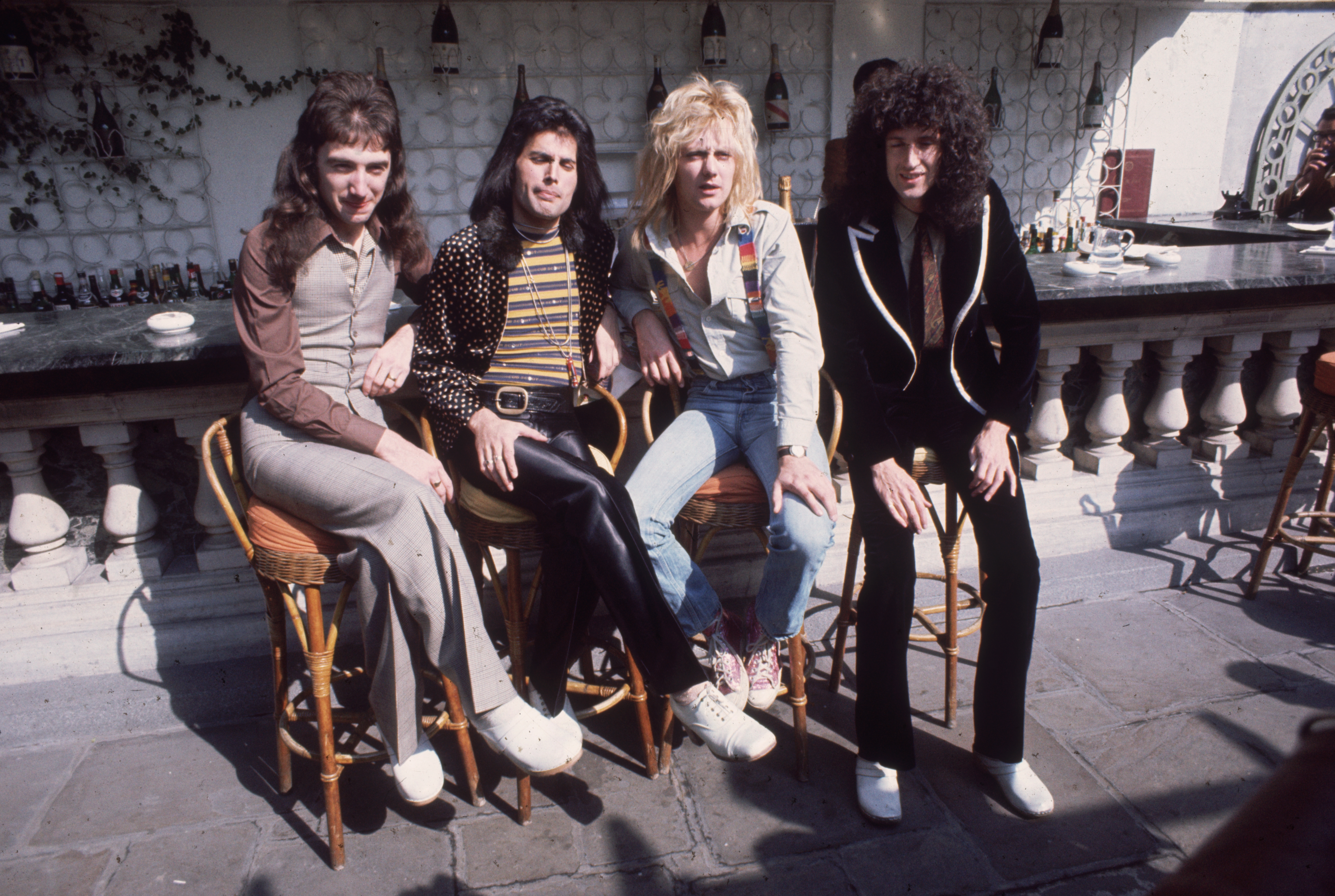 British rock group Queen at Les Ambassadeurs, where they were presented with silver, gold and platinum discs for sales in excess of one million of their hit single 'Bohemian Rhapsody'. The band are, from left to right, John Deacon, Freddie Mercury (Frederick Bulsara, 1946 - 1991), Roger Taylor and Brian May. (Getty Images)