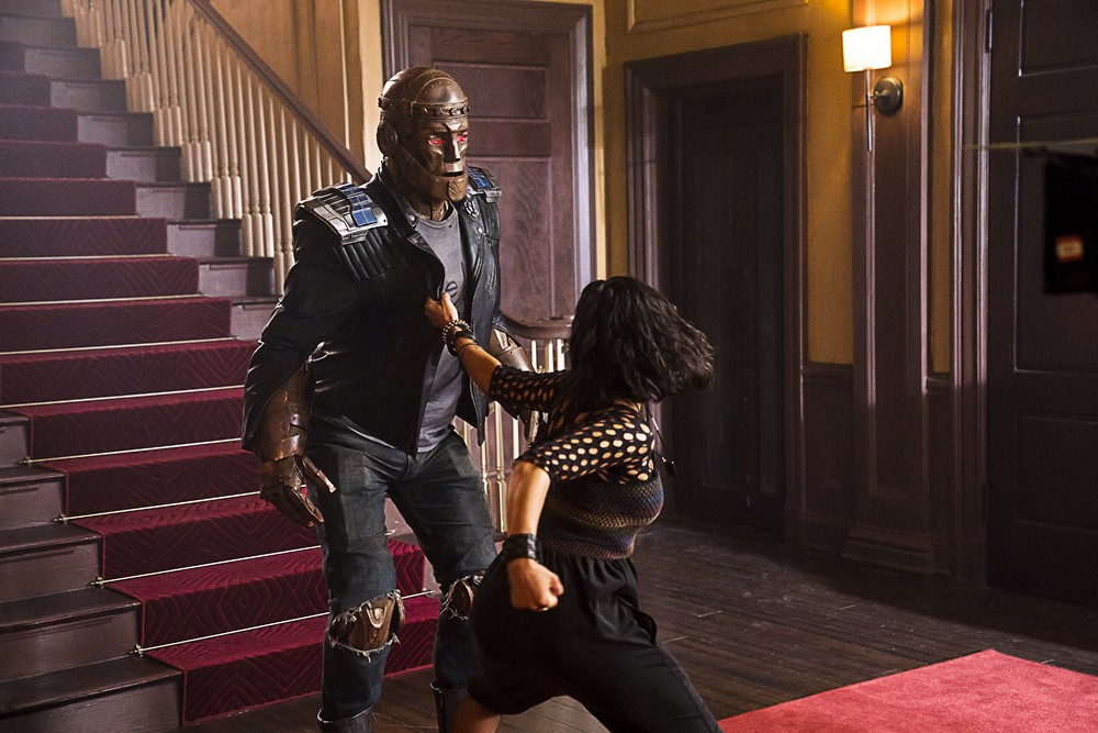 Crazy Jane turning into Hammerhead and punching Robotman up a flight of stairs in 'Doom Patrol. (Source: WBTV)