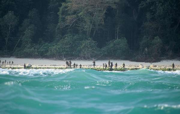 The Sentinelese stand guard on an island beach. (Courtesy: Christian Caron for Survival International - Representational purposes only)
