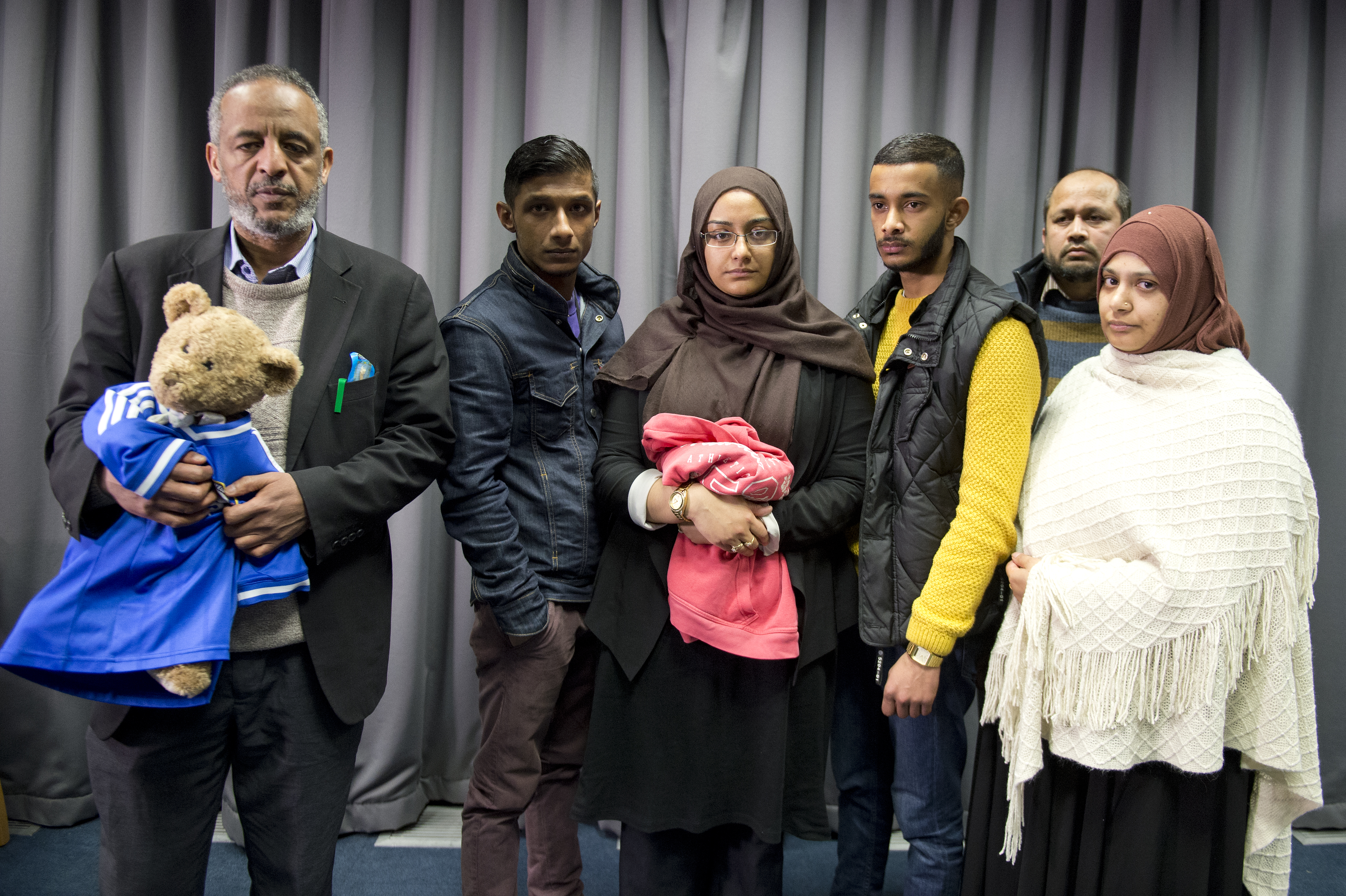 The families of Amira Abase and Shamima Begum, the three missing schoolgirls believed to have fled to Syria to join Islamic State, pose after being interviewed by the media at New Scotland Yard, after pleading for them to return home, on February 22, 2015, in London, England. (Getty Images)