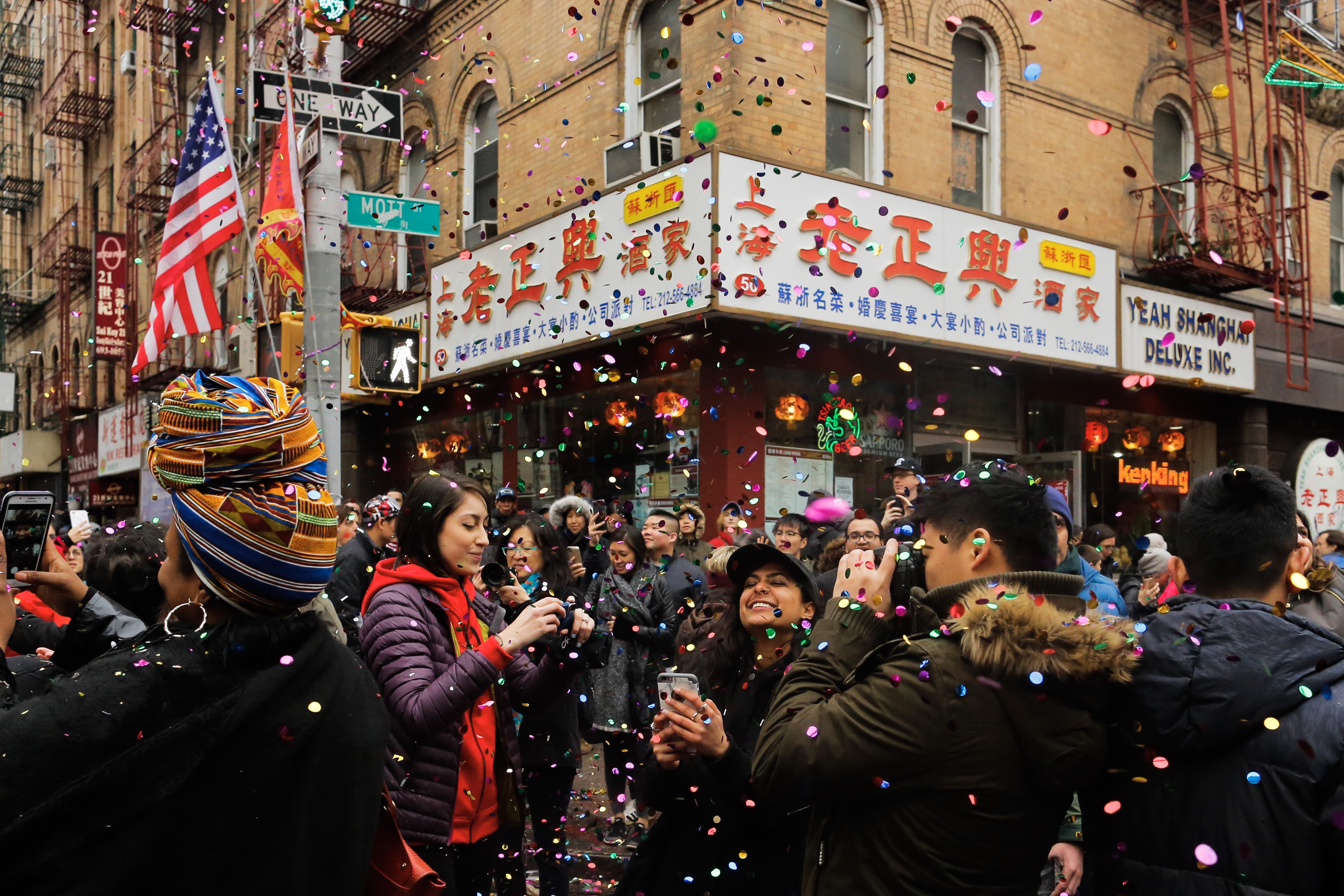 People take part in the Chinese Lunar New Year parade in Chinatown on February 25, 2018 in New York City (Getty Images)