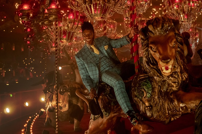 Mr. Nancy on the carousel before entering 'Backstage' in 'American Gods' season 2 episode 1. (Source: Starz)