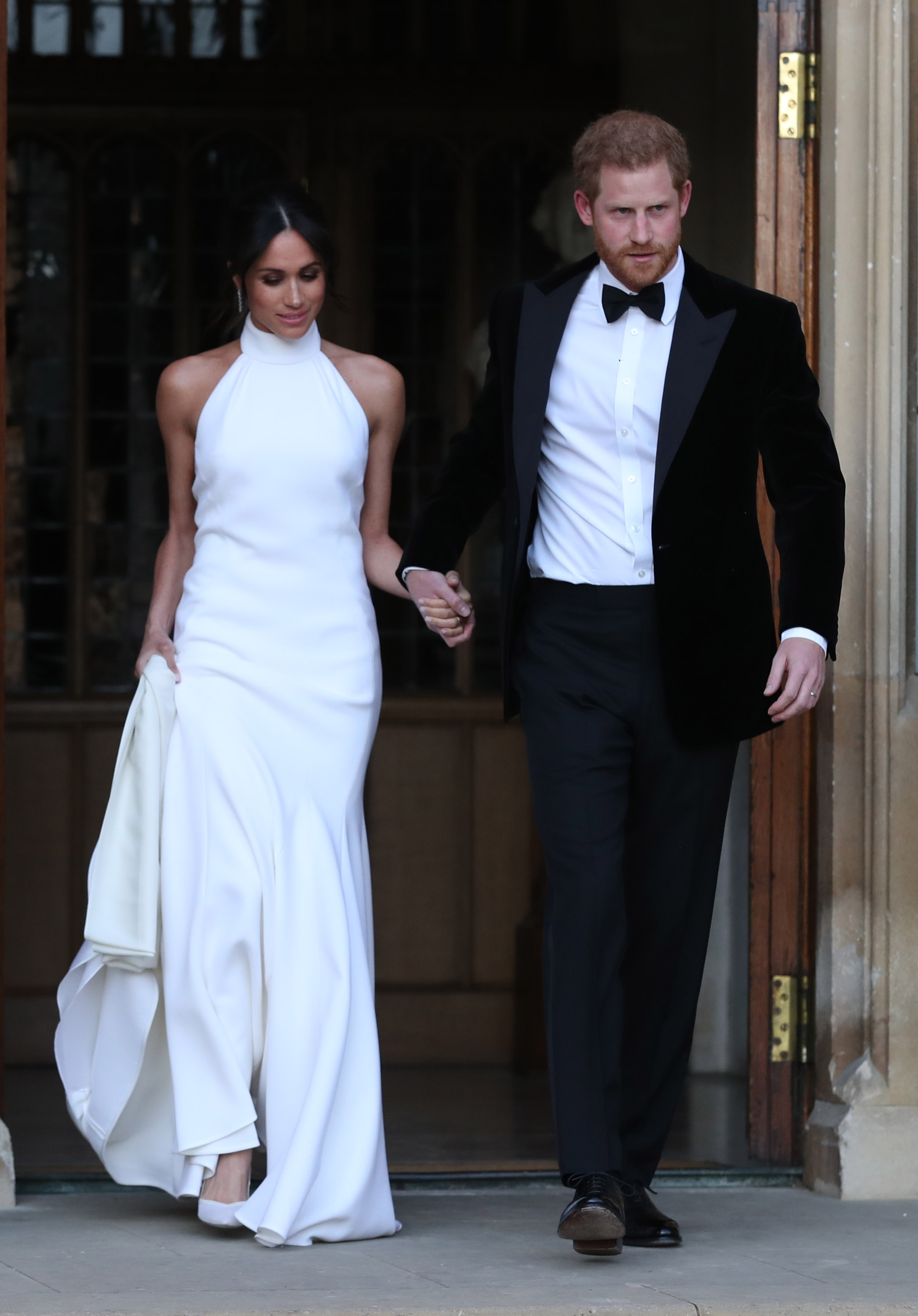 Duchess of Sussex and Prince Harry, Duke of Sussex leave Windsor Castle after their wedding to attend an evening reception at Frogmore House, hosted by the Prince of Wales on May 19, 2018, in Windsor, England. (Getty Images)