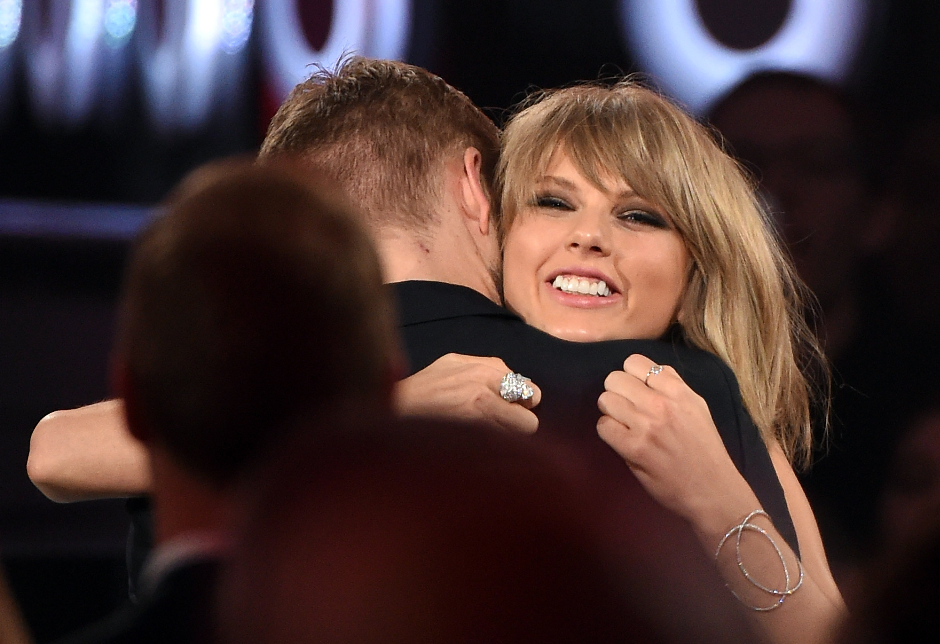 Recording artist Taylor Swift embraces DJ/producer Calvin Harris after she won the Top Billboard 200 Album award during the 2015 Billboard Music Awards at MGM Grand Garden Arena on May 17, 2015 in Las Vegas, Nevada.