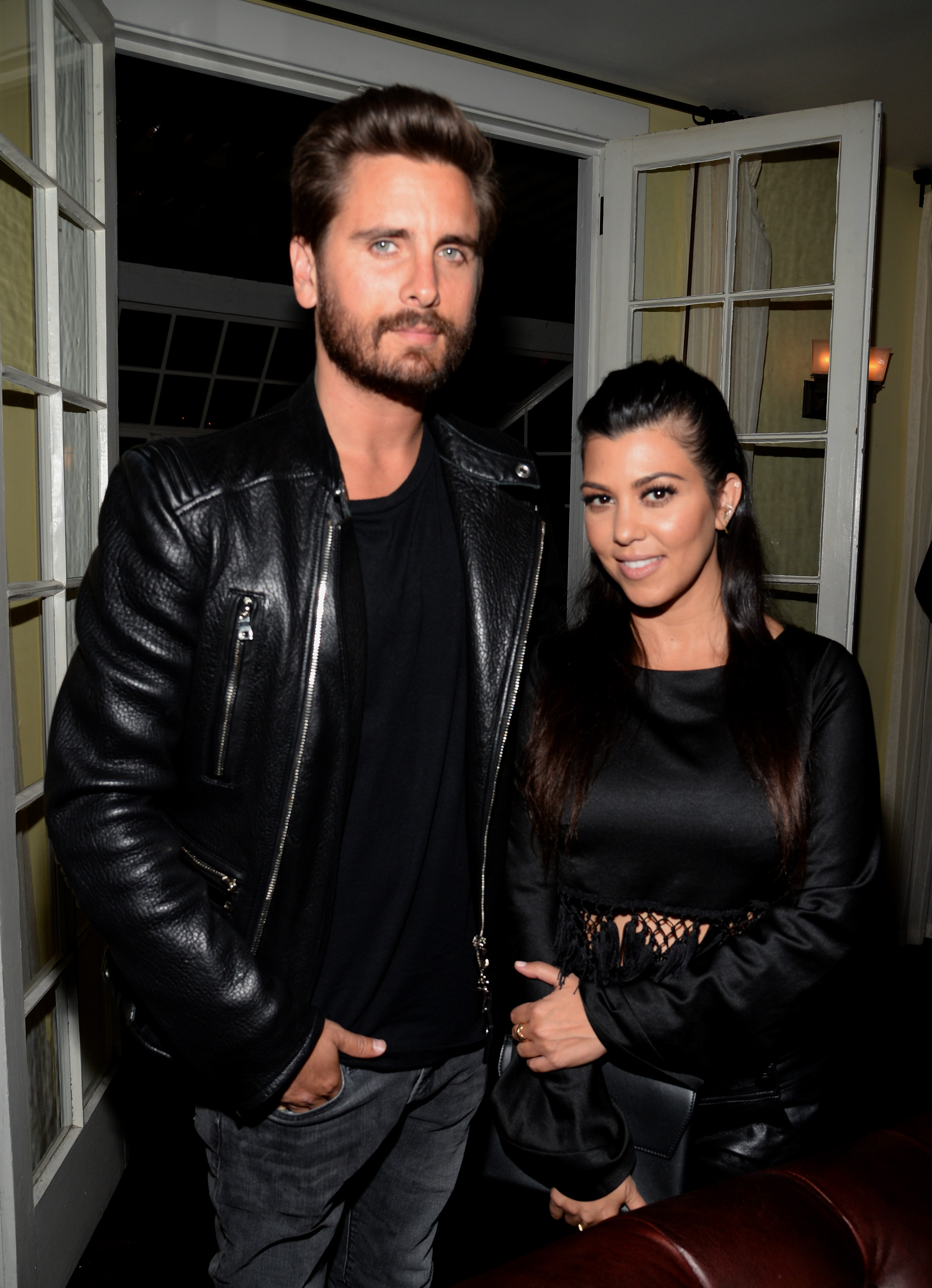 TV personalities Scott Disick (L) and Kourtney Kardashian attend Opening Ceremony and Calvin Klein Jeans' celebration launch of the #mycalvins Denim Series with special guest Kendall Jenner at Chateau Marmont on April 23, 2015 in Los Angeles, California.