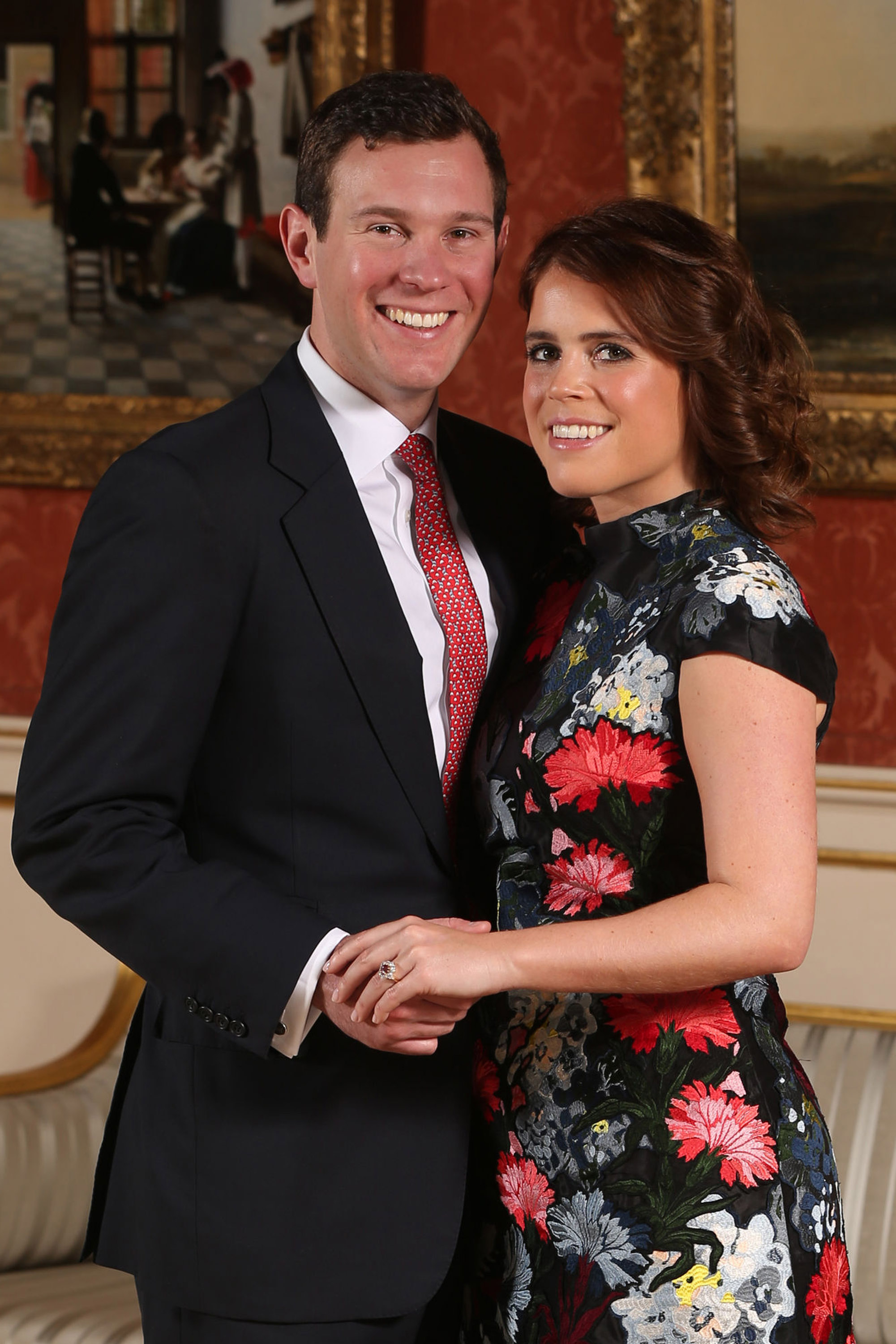 Princess Eugenie and Jack Brooksbank pose in the Picture Gallery at Buckingham Palace after they announced their engagement. They are to marry at St George's Chapel in Windsor Castle in the autumn this year. (Getty Images)