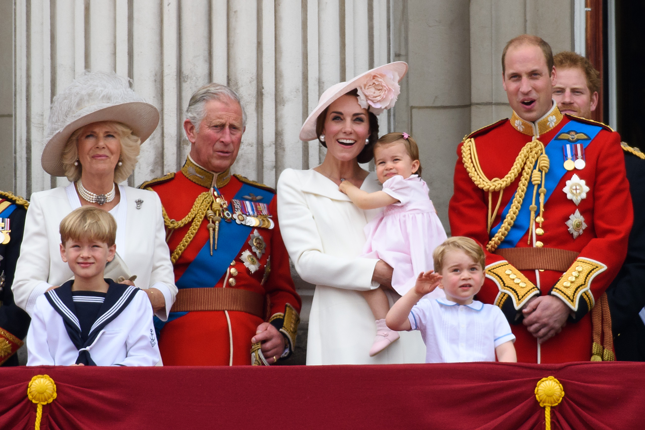 (L-R) Camilla, Duchess of Cornwall, Prince Charles of Wales, Catherine, Duchess of Cambridge, Princess Charlotte of Cambridge, Prince George Of Cambridge and Prince William, Duke of Cambridge watch a fly past during the Trooping the Colour, this year marking the Queen's 90th birthday at The Mall on June 11, 2016 in London, England. The ceremony is Queen Elizabeth II's annual birthday parade and dates back to the time of Charles II in the 17th Century when the Colours of a regiment were used as a rallying point in battle.