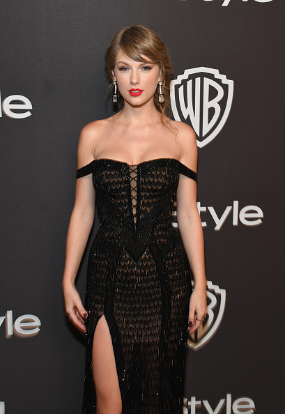 Taylor Swift picked a beautiful off-the-shoulder black sequin Atelier Versace dress that featured a thigh-high slit (Source: Getty Images)