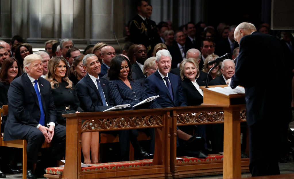 From left, President Donald Trump, first lady Melania Trump, former President Barack Obama, former first lady Michelle Obama, former President Bill Clinton, former Secretary of State Hillary Clinton, and former President Jimmy Carter listen as former Sen. Alan Simpson, R-Wyo., speaks during the state funeral for former U.S. President George H. W. Bush at the Washington National Cathedral on December 5, 2018 in Washington, DC. (Photo by Alex Brandon - Pool/Getty Images)