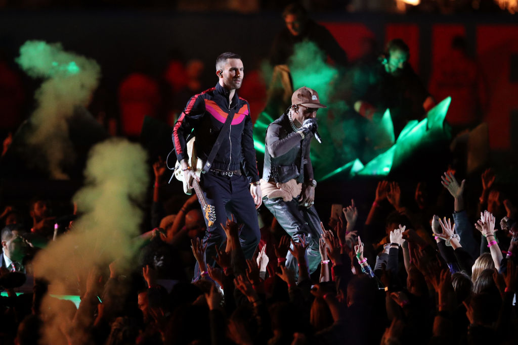 Adam Levine of Maroon 5 and Travis Scott perform during the Pepsi Super Bowl LIII Halftime Show at Mercedes-Benz Stadium on February 03, 2019, in Atlanta, Georgia. (Photo by Patrick Smith/Getty Images)