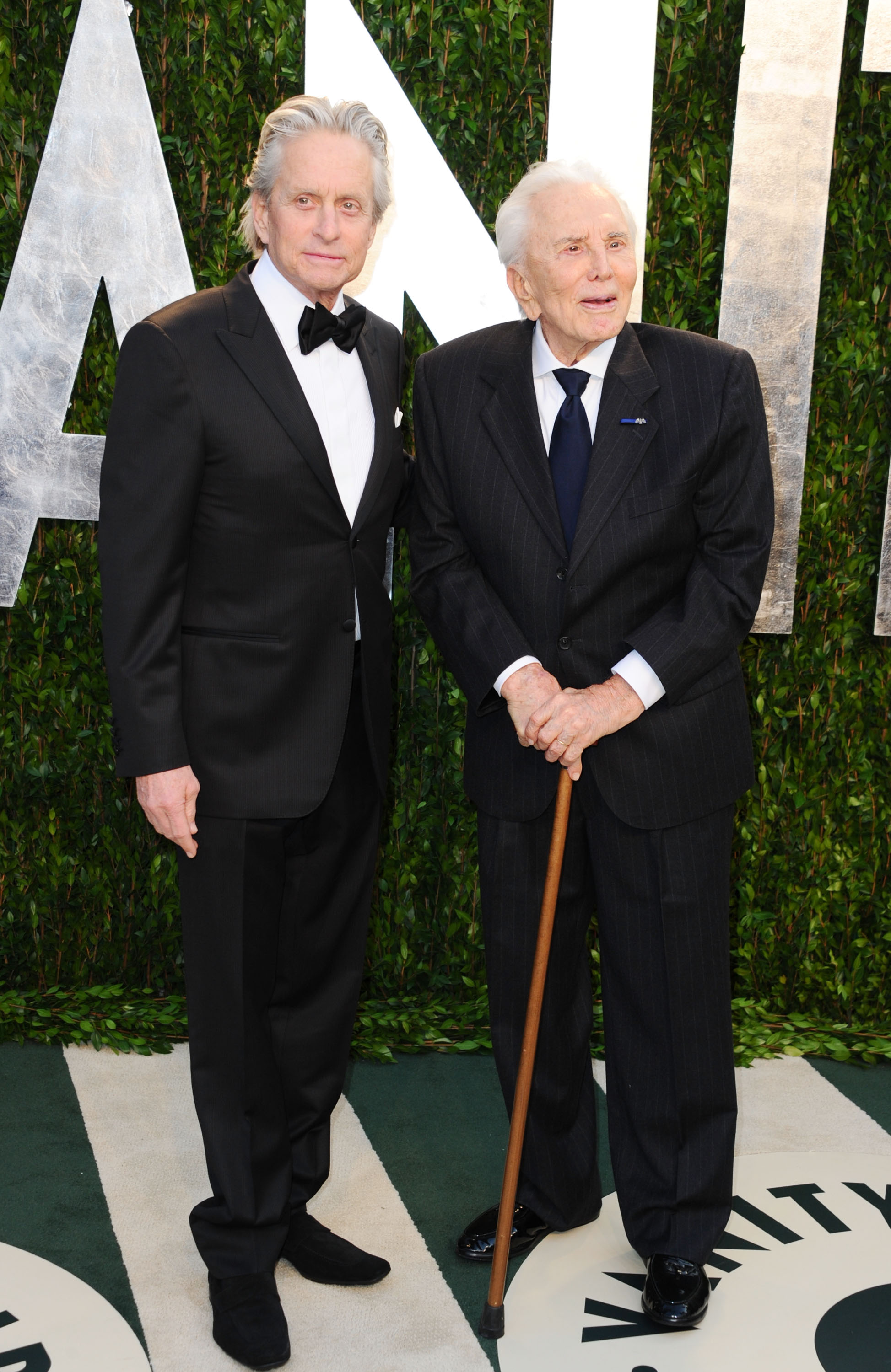 Actors Michael Douglas and Kirk Douglas arrive at the 2012 Vanity Fair Oscar Party hosted by Graydon Carter at Sunset Tower on February 26, 2012, in West Hollywood, California. (Getty Images)