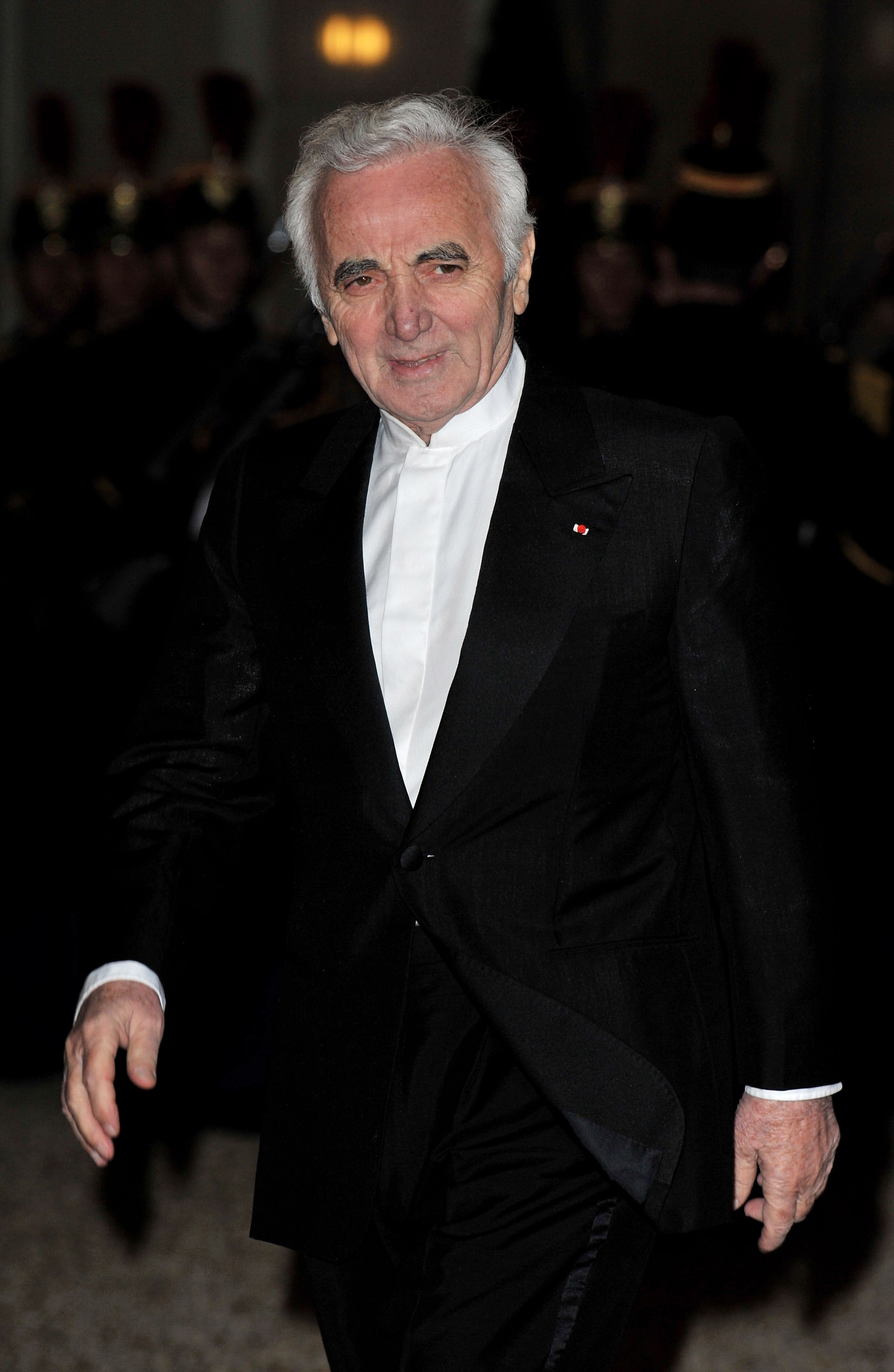 Singer Charles Aznavour arrives to attend a state dinner honouring visiting Russian President Dmitry Medvedev at the Elysee Palace on March 2, 2010 in Paris, France.