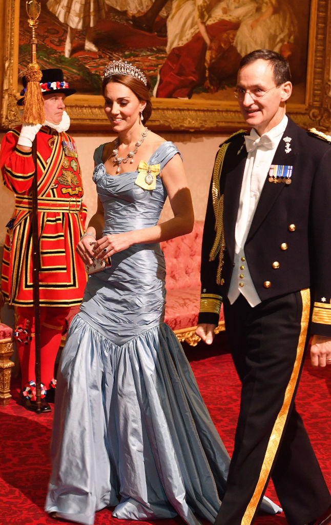 Catherine, Duchess of Cambridge, walks with Rear Admiral Ludger Brummelaar during a State Banquet at Buckingham Palace on October 23, 2018, in London, United Kingdom. (Getty Images)