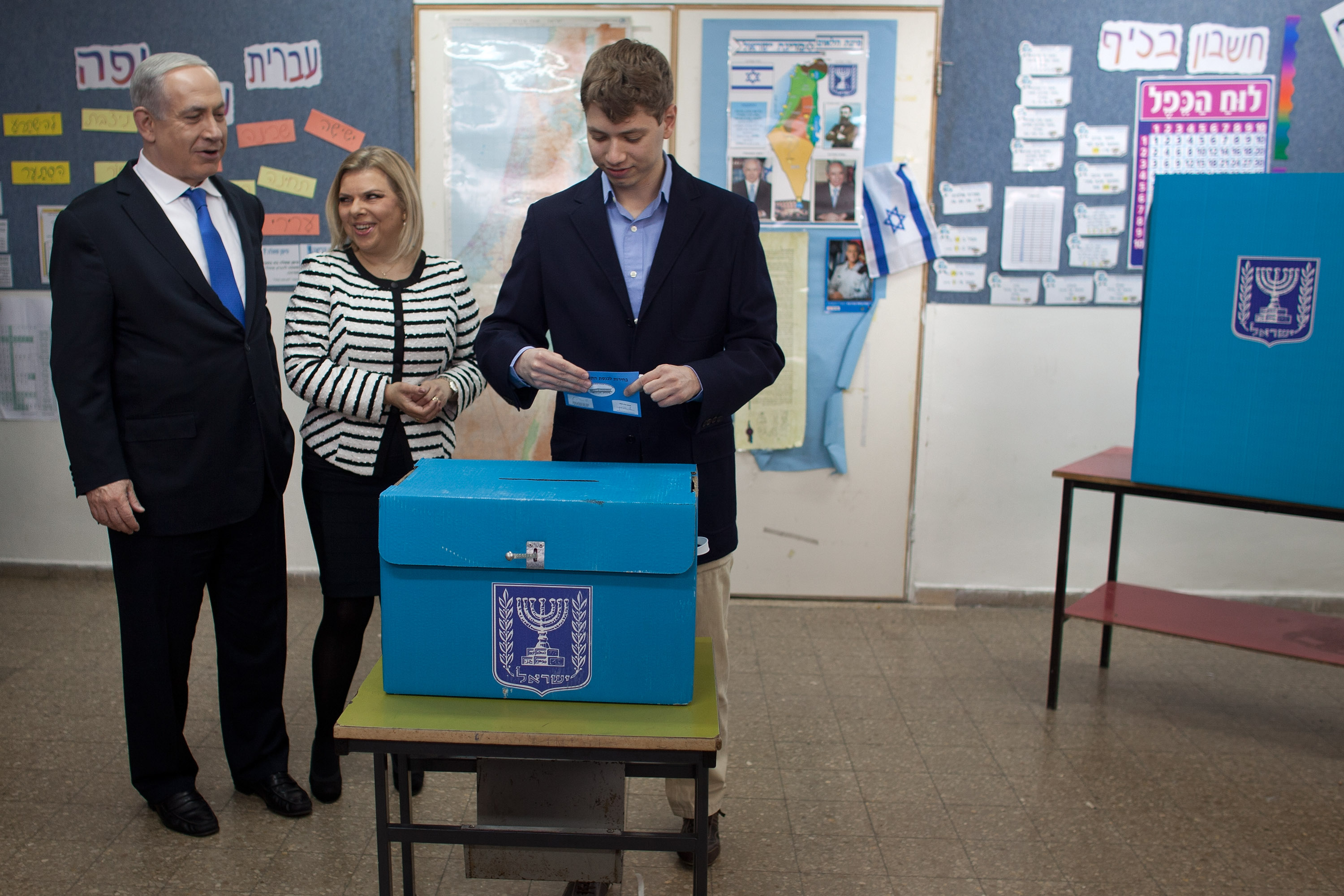 Israeli Prime Minister Benjamin Netanyahu watches his son Yair Netanyahu cast his ballot with by wife Sara Netanyahu at a polling station on election day on January 22, 2013, in Jerusalem, Israel. (Getty Images)
