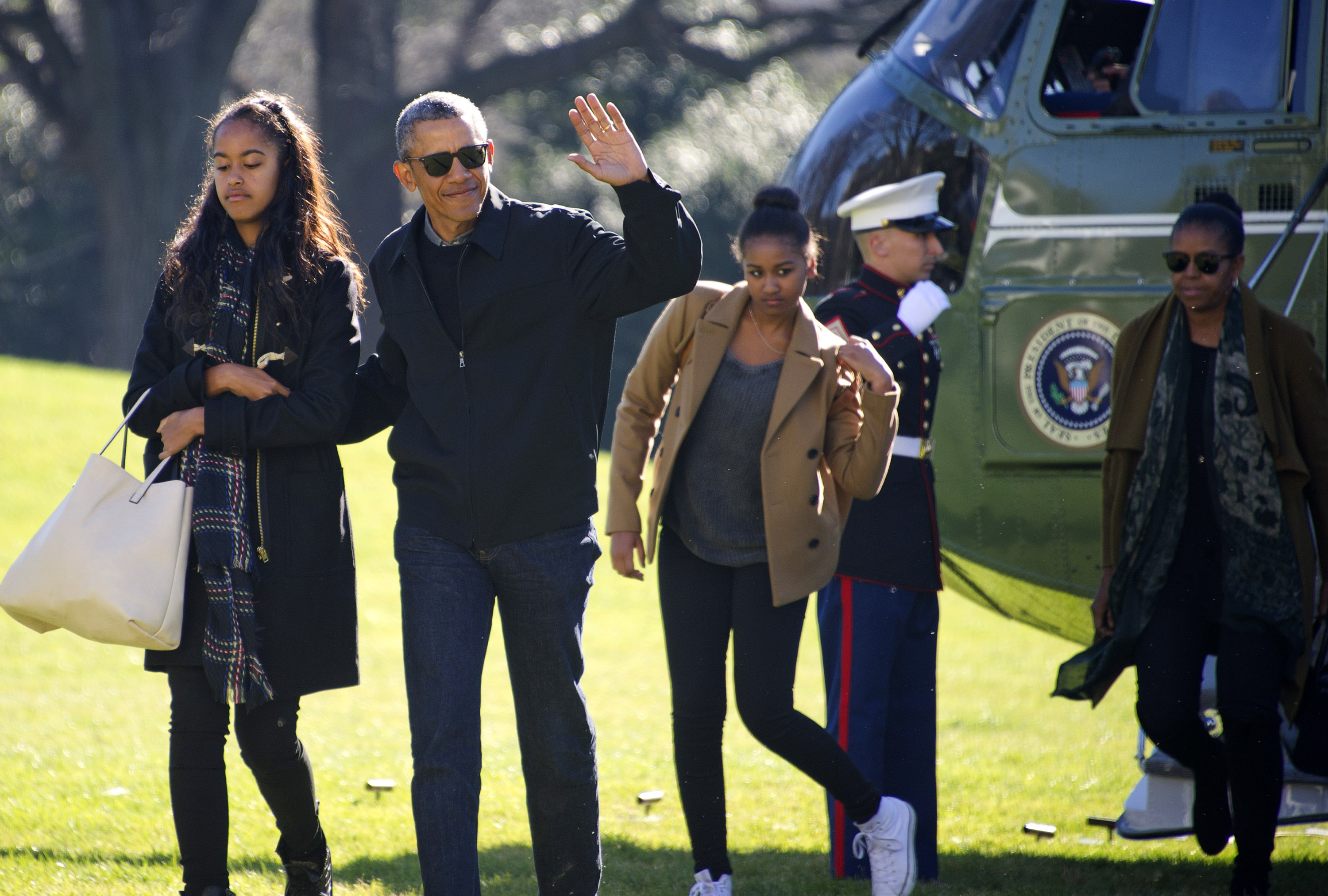 US President Barack Obama and his family (L-R) Malia, Sasha, and first lady Michelle Obama return to the South Lawn of the White HouseJanuary 3, 2016 in Washington, DC. The first family is returning from their two-week Hawaiian vacation. (Getty Images)