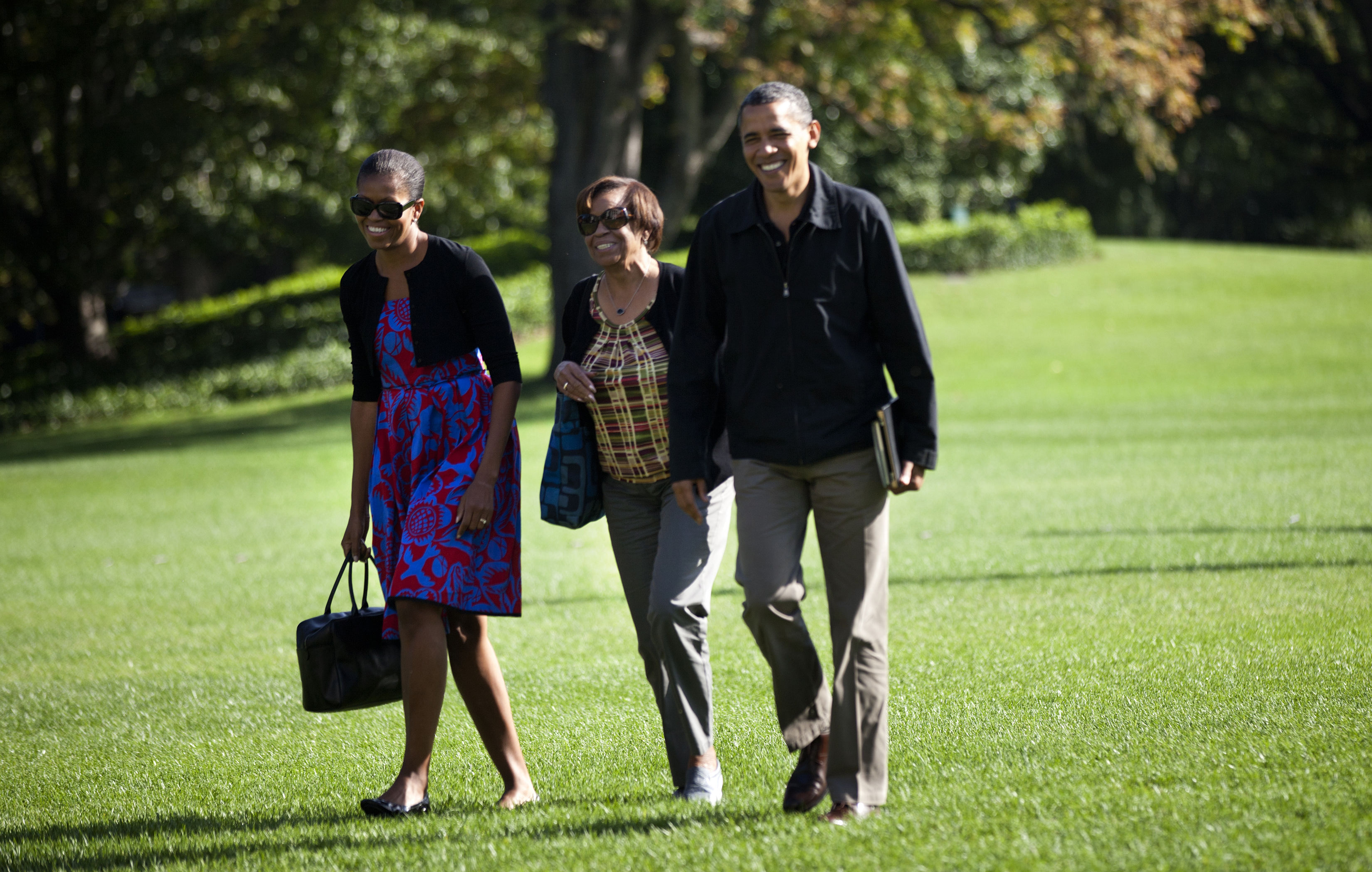 President Barack Obama walks with First Lady Michelle Obama (L) and his mother-in-law Marian Robinson from Marine One to the Residence of the White House October 9, 2011, in Washington, DC. (Getty Images)