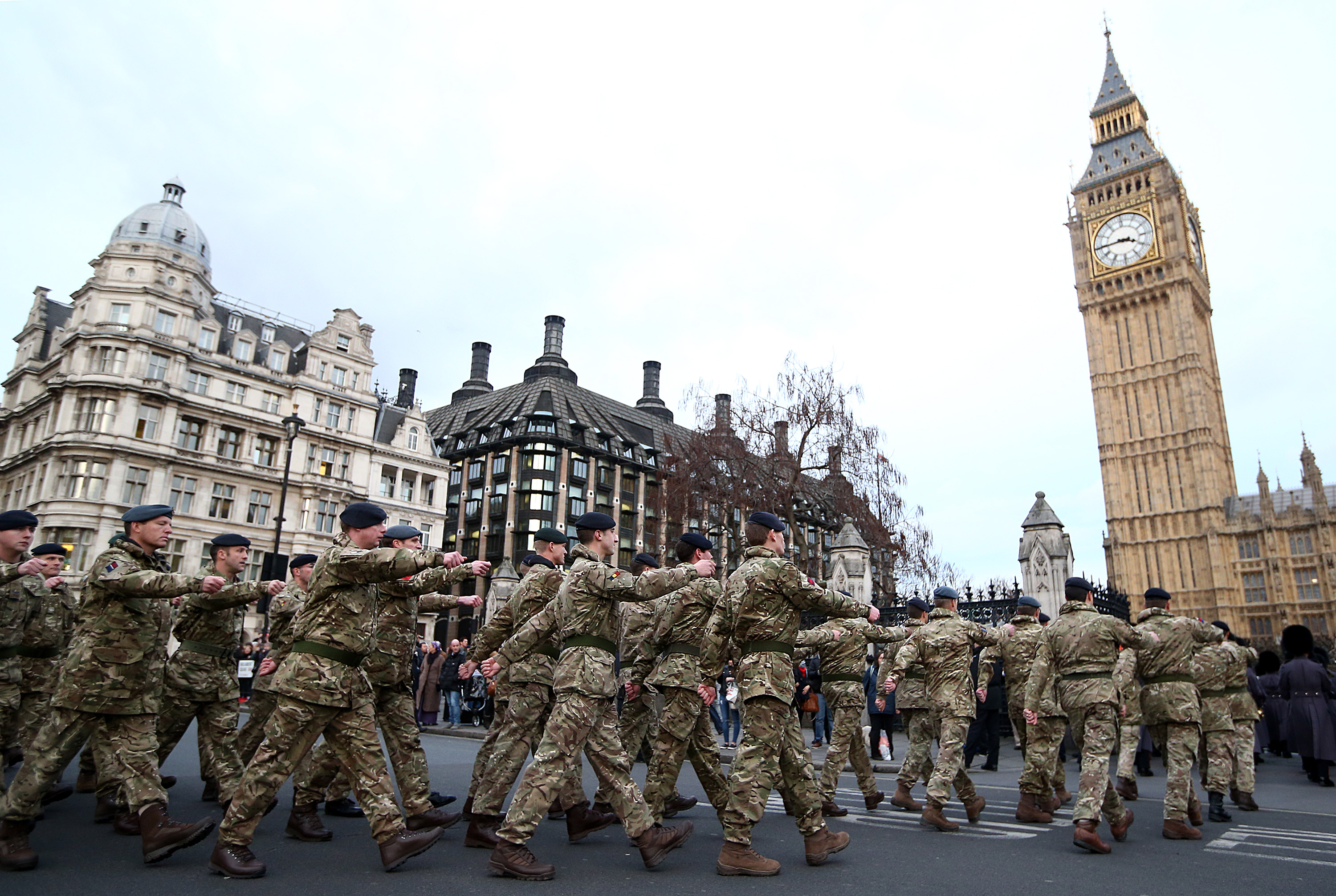 Military personnel march into the Houses of Parliament on January 26, 2015 in London, England. 120 military personnel from all three services were accompanied by the Band of the Grenadier Guards as they marched from Wellington Barracks to the Houses of Parliament. The march was led by Commander 102 Logistics Brigade Brigadier Darrell Amison, the final Commander of Joint Force Support for Operation Herrick and is their final march into their Houses of Parliament.