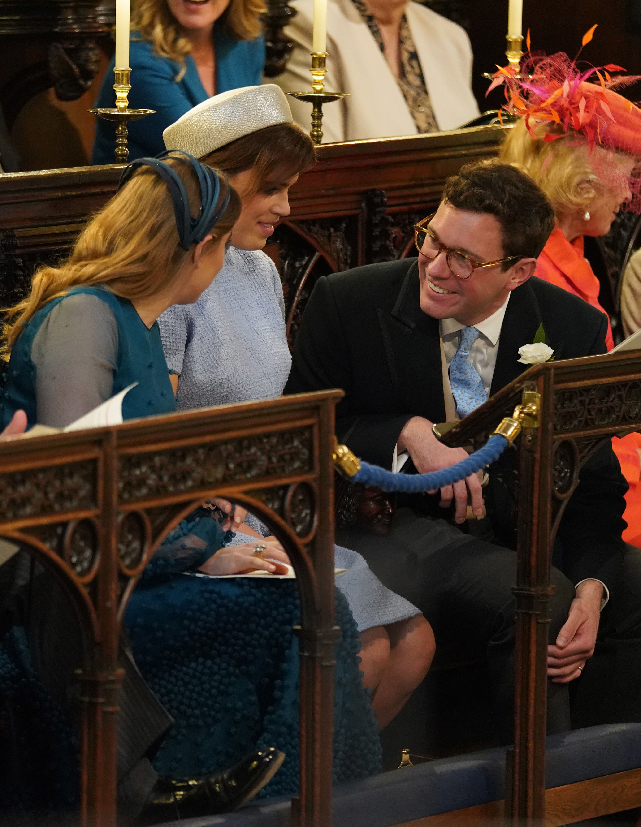 (L-R) Princess Beatrice (left), Princess Eugenie and Jack Brooksbank take their seats at St George's Chapel at Windsor Castle before the wedding of Prince Harry to Meghan Markle on May 19, 2018 in Windsor, England.