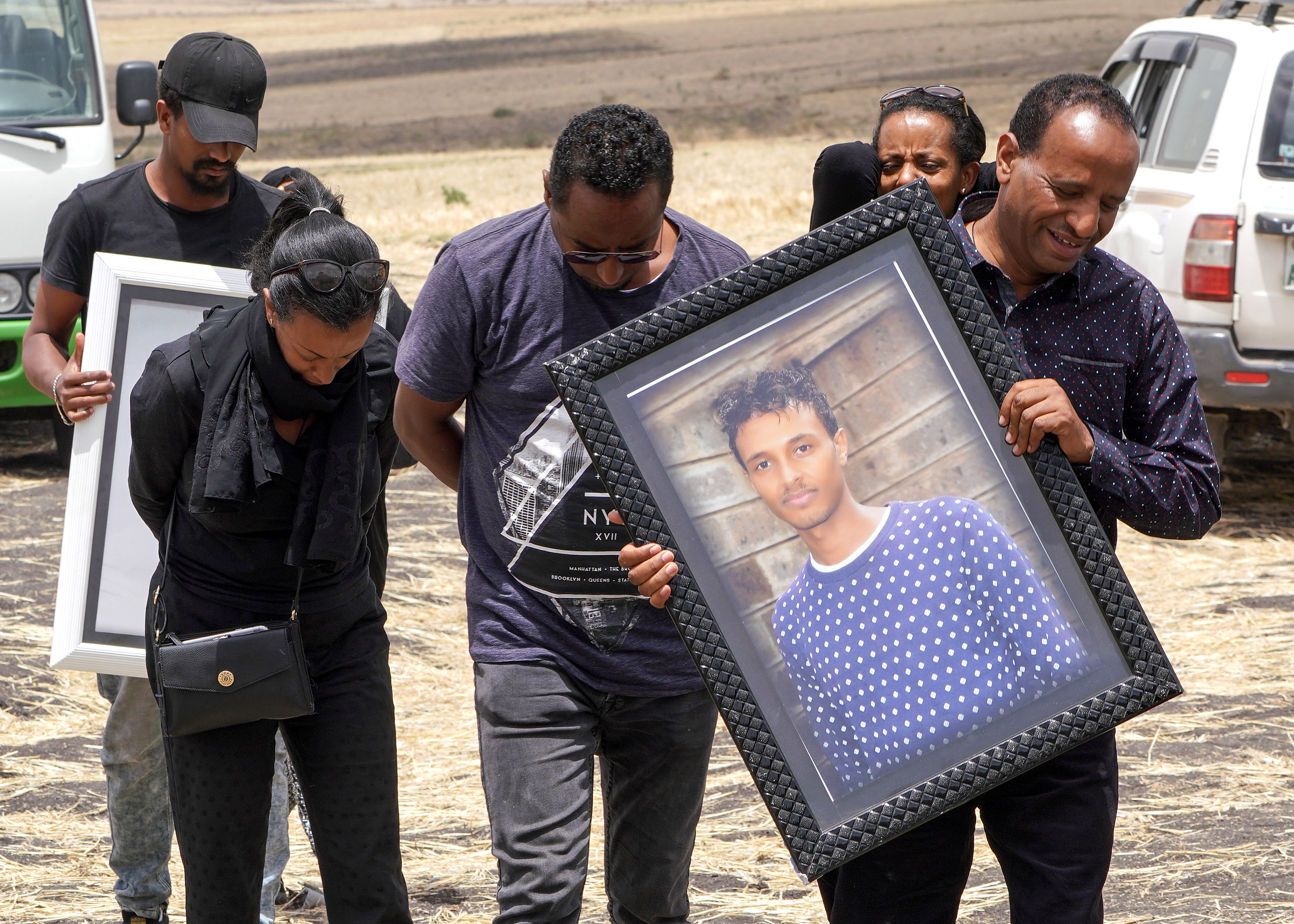 Family members of 28-year-old Captain Yared Getecho visit the crash site of Ethiopian Airlines Flight ET302 on March 14, 2019, in Ejere, Ethiopia. (Getty)