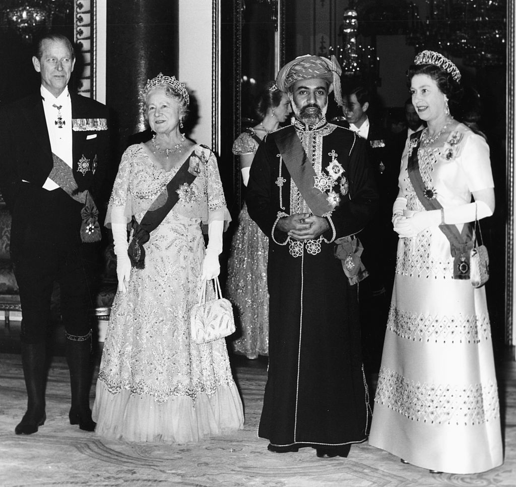 Qaboos Bin Said Al Said (second right), the Sultan of Muscat and Oman, with Queen Elizabeth II (right), the Queen Mother and the Duke of Edinburgh, at a banquet held in the Sultan's honor at Buckingham Palace, London, March 17th 1982. (Photo by Geoff Bruce/Central Press/Getty Images)