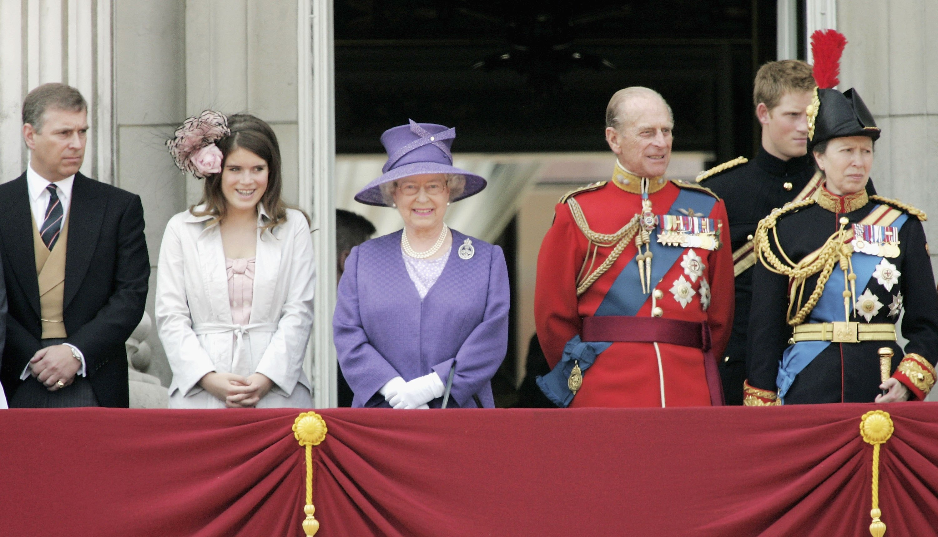 (L-R) Prince Andrew, Duke of York, Princess Eugenie, Queen Elizabeth II, Prince Philip, Duke of Edinburgh, Prince Harry and Princess Anne, Princess Royal stand on the balcony of Buckingham Palace following Trooping of The Queen's Colour of First Battalion Grenadier Guards, marking The Queen's official birthday, at Horse Guards Parade on June 17, 2006 in London, England.