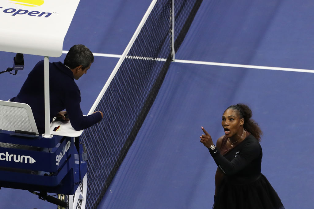 Serena Williams argues with umpire Carlos Ramos during her US Open Women's Singles final against Naomi Osaka on September 8, 2018 (Photo by Alex Pantling/Getty Images)