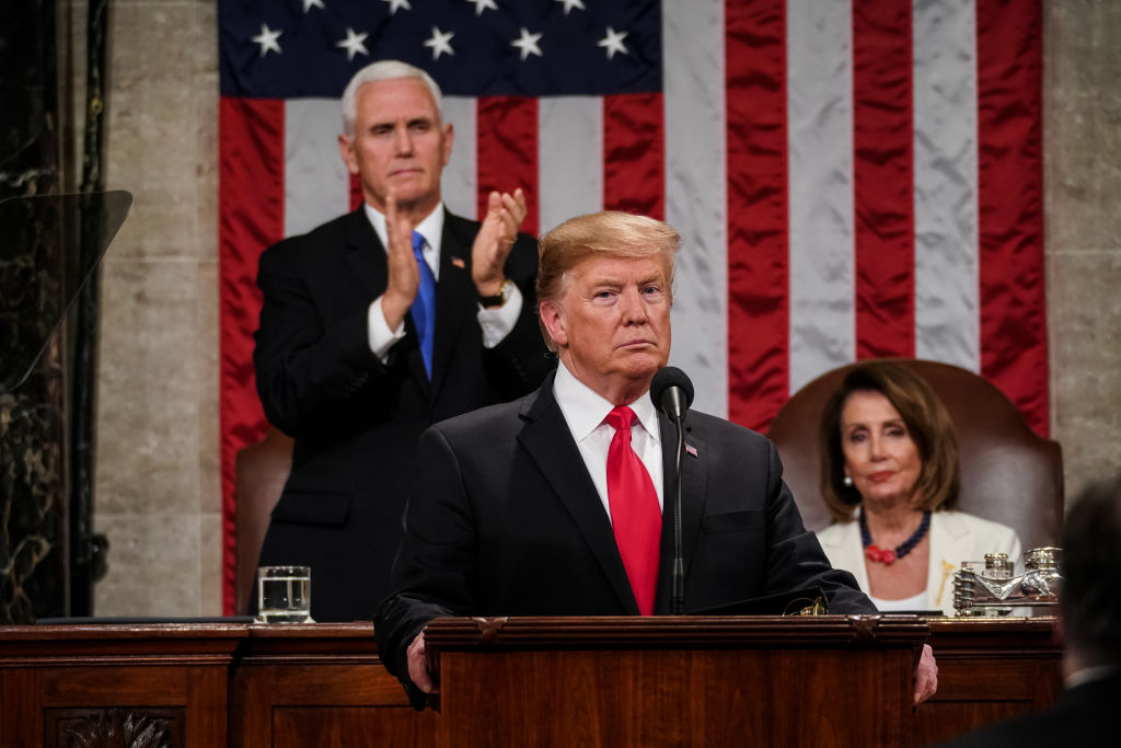 U.S. President Donald Trump, with Speaker Nancy Pelosi and Vice President Mike Pence looking on, delivers the State of the Union address in the chamber of the U.S. House of Representatives at the U.S. Capitol Building on February 5, 2019 in Washington, DC. (Getty Images)