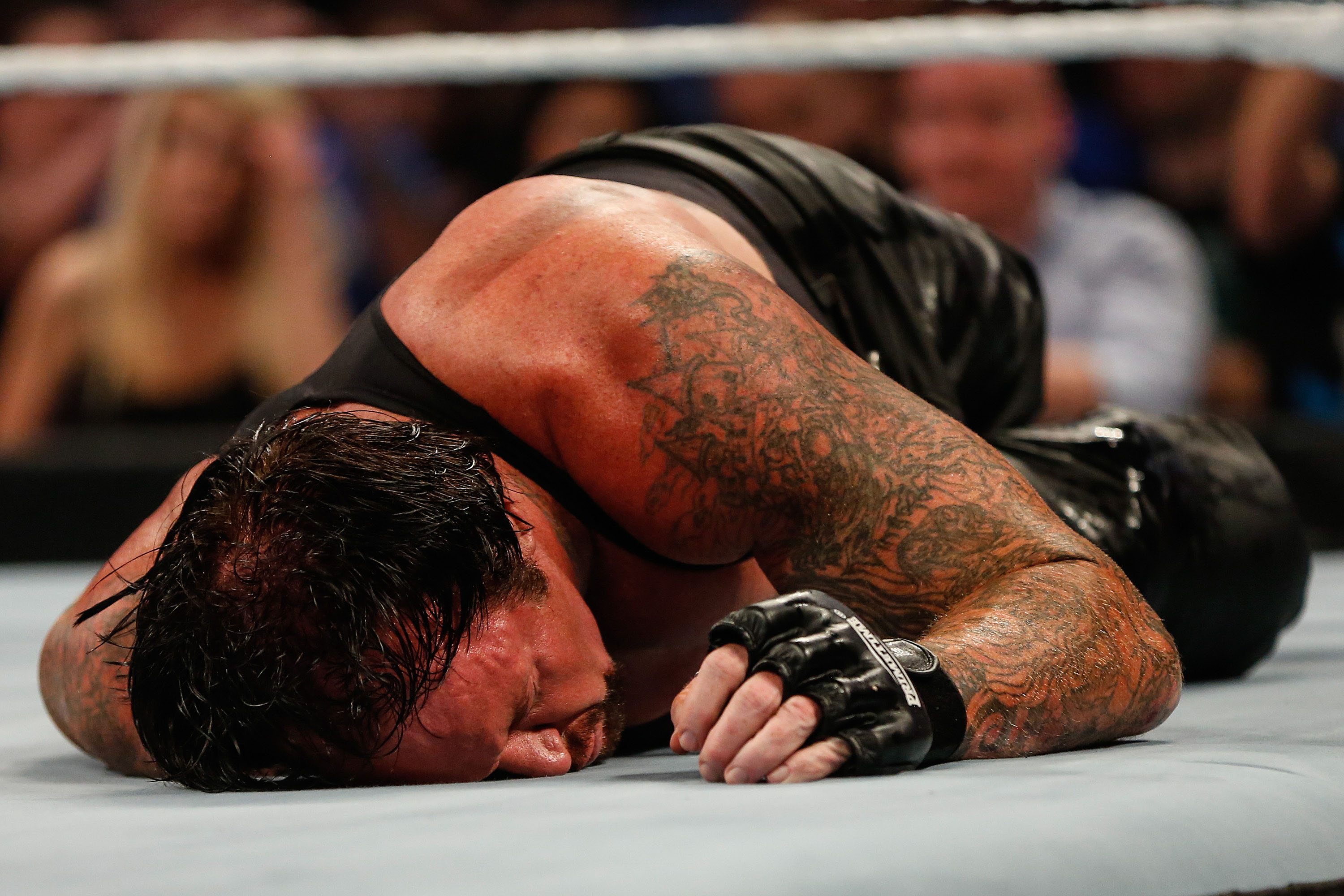 The Undertaker gets beaten to the ground at the WWE SummerSlam 2015 at Barclays Center of Brooklyn on August 23, 2015 in New York City. (Photo by JP Yim/Getty Images)