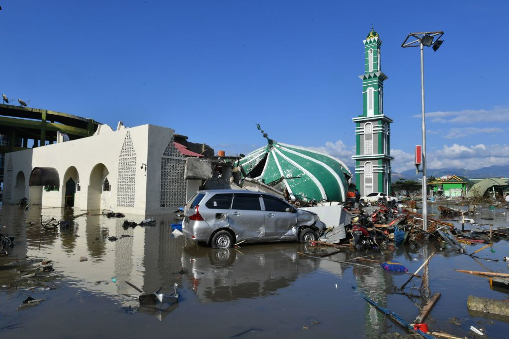 A collapsed mosque is seen amid waters from a tsunami surge in Palu, Indonesia's Central Sulawesi on September 30, 2018, following the September 28 earthquake and tsunami. The death toll in Indonesia rose to 832 on September 30. (Getty Images)
