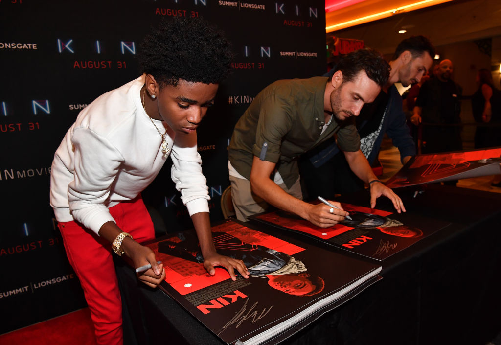 (L-R) Myles Truitt, Josh Baker and Jonathan Baker sign movie posters during 'Kin' Atlanta screening at Regal Atlantic Station on August 20, 2018 in Atlanta, Georgia. (Photo by Paras Griffin/Getty Images for Lionsgate)