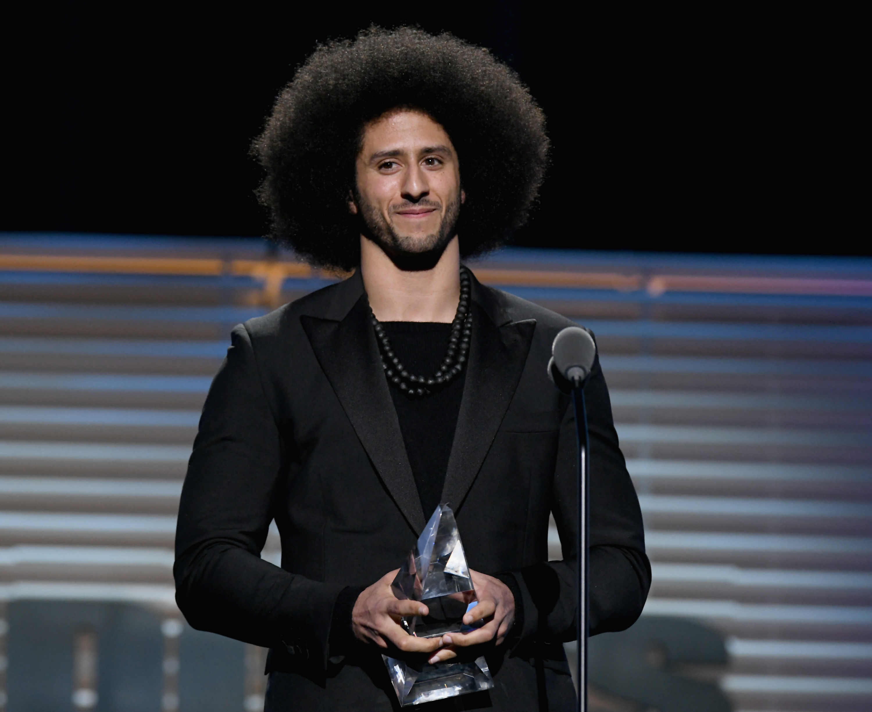 Colin Kaepernick receives the SI Muhammad Ali Legacy Award during SPORTS ILLUSTRATED 2017 Sportsperson of the Year Show on December 5, 2017, at Barclays Center in New York City. (Getty Images)